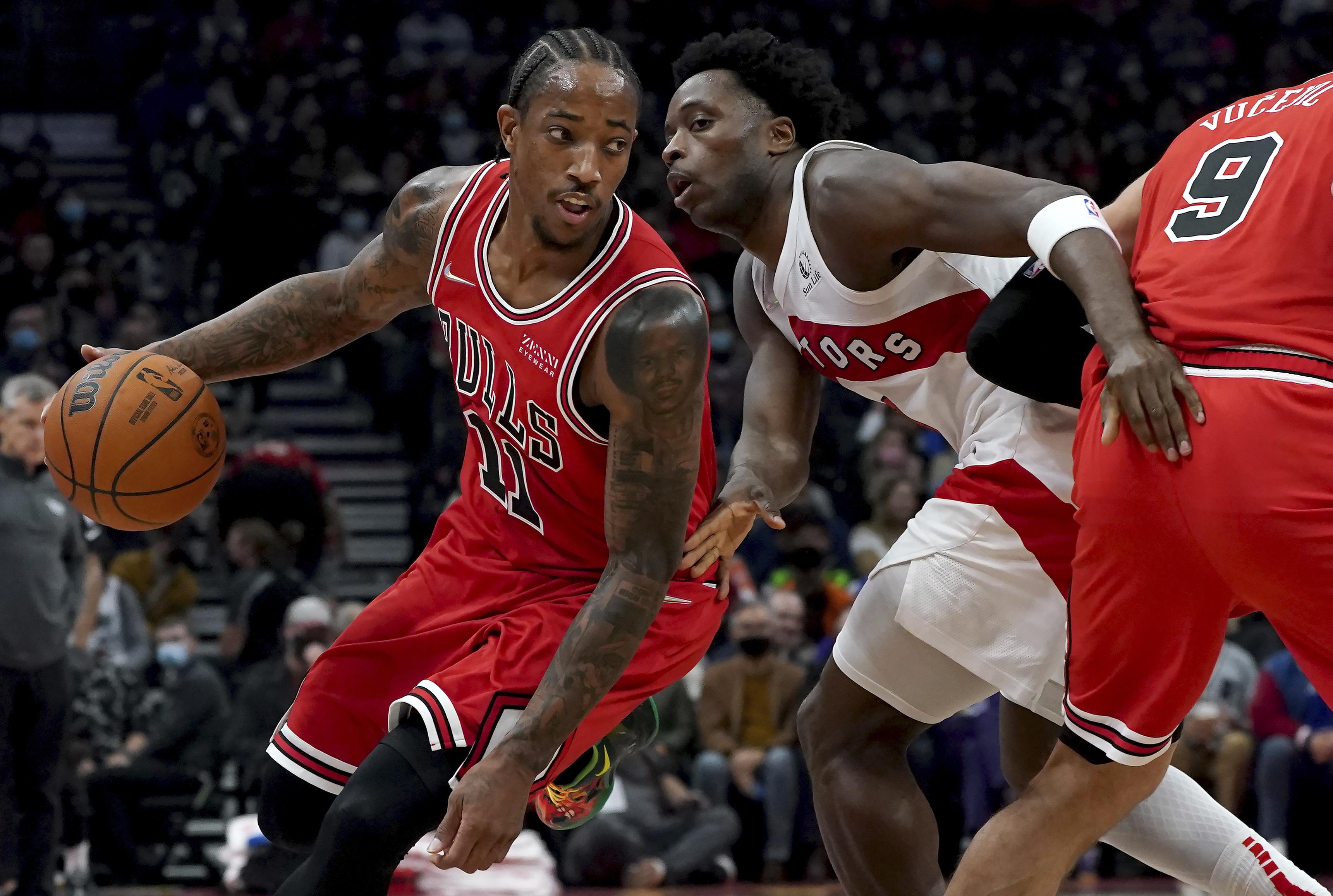 Bulls forward DeMar DeRozan moves around Toronto Raptors forward OG Anunoby.