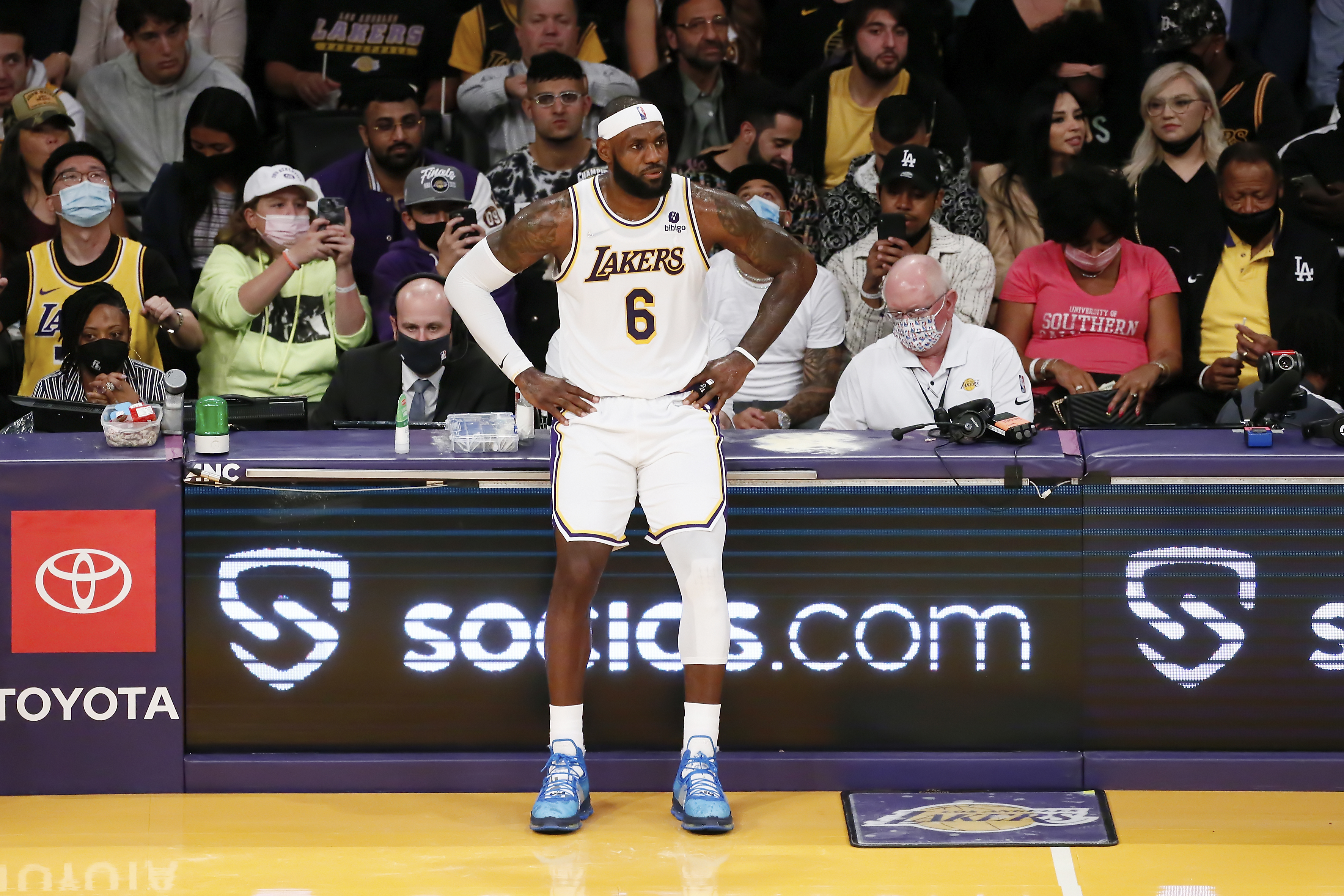 LeBron James #6 of the Los Angeles Lakers waits to enter the game during a game at the STAPLES Center on October 24, 2021 in Los Angeles, California.