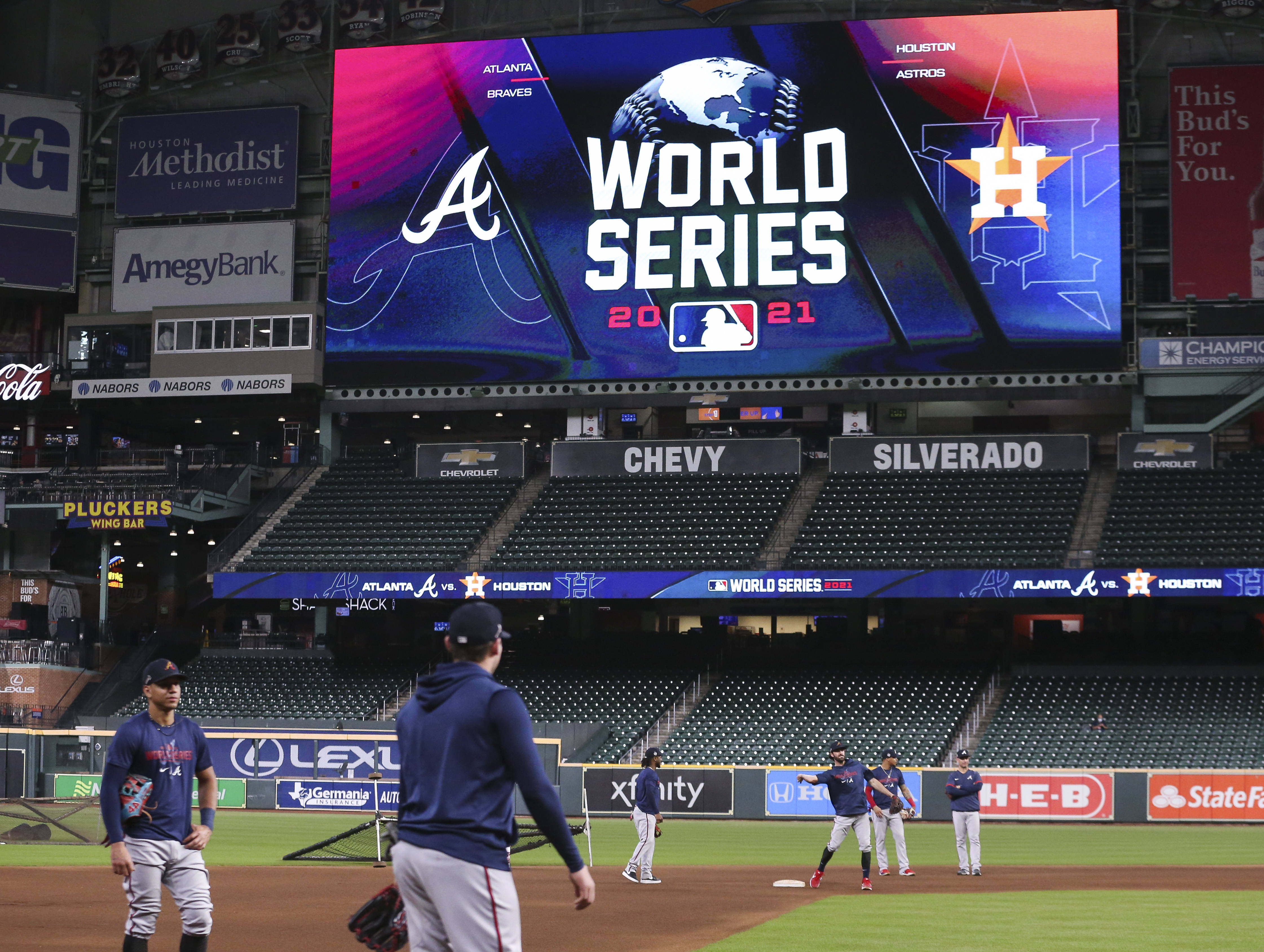Atlanta Braves players practice during workouts before Game 1 of the World Series between the Houston Astros and the Atlanta Braves at Minute Maid Park