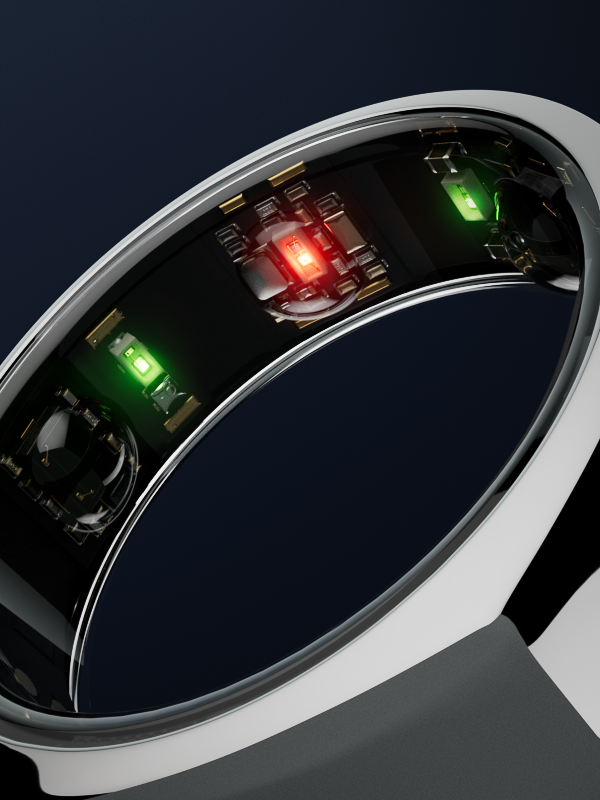 Inside of the Oura ring, showing red and green LED lights.
