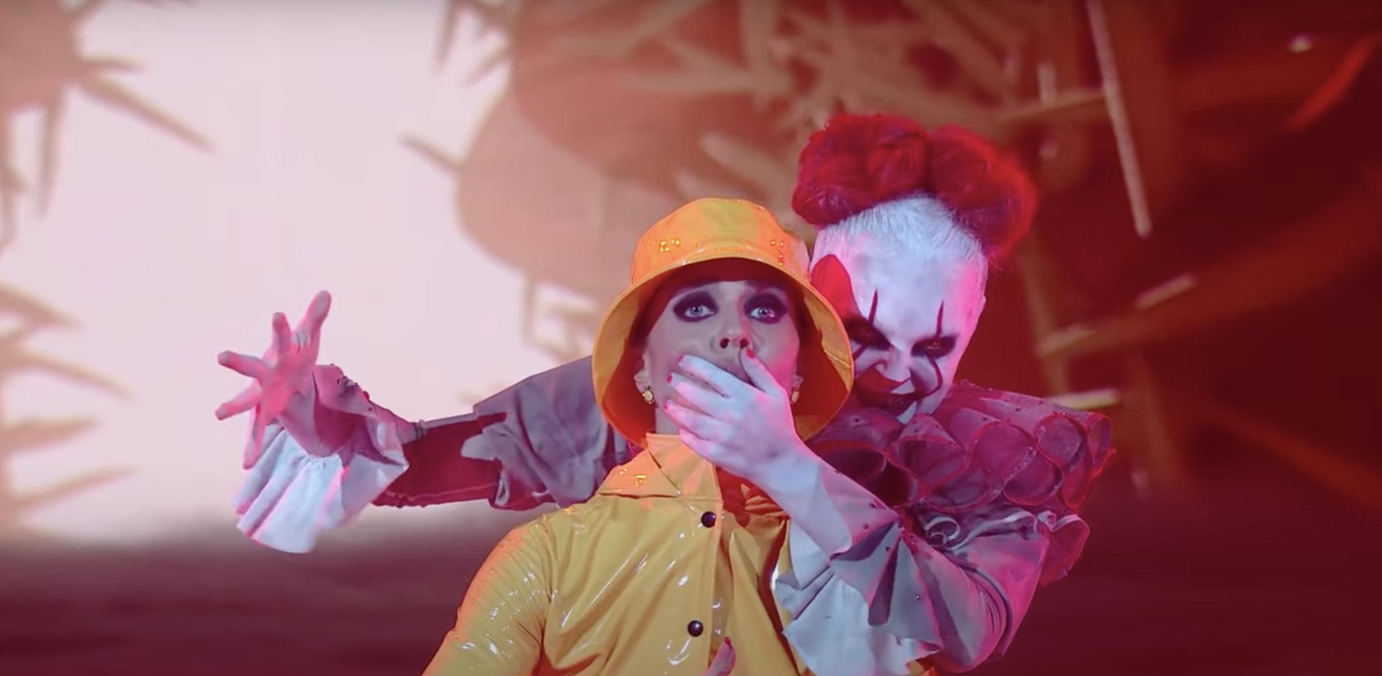 jojo siwa, but dressed as a spooky clown, sneaking up on Jenna Johnson who wears a yellow raincoat