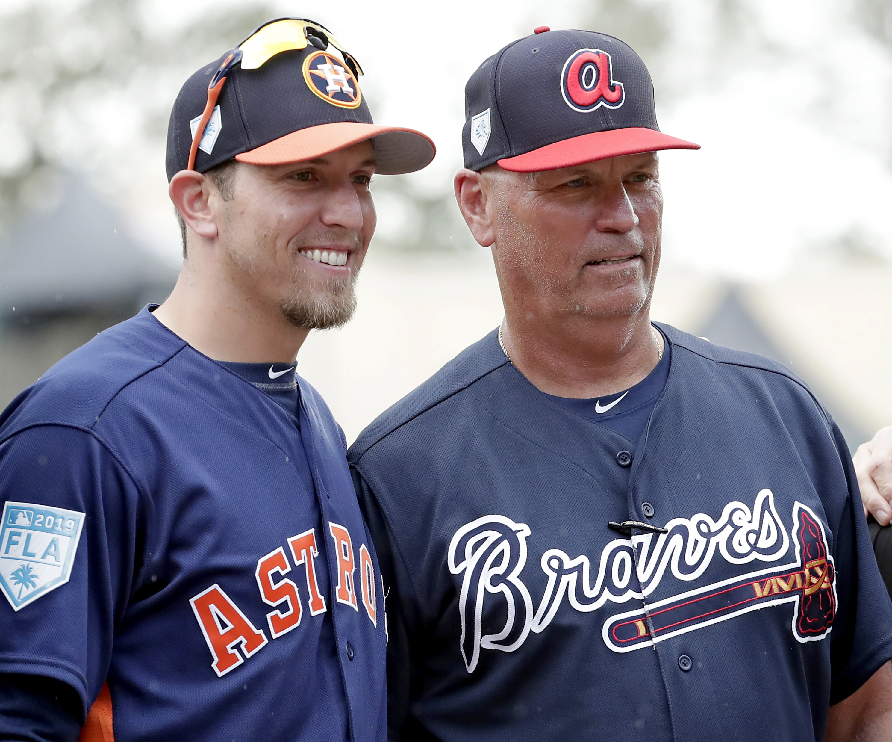 Houston Astros co-hitting coach Troy Snitker, left, stands with his father, Atlanta Braves manager Brian Snitker.