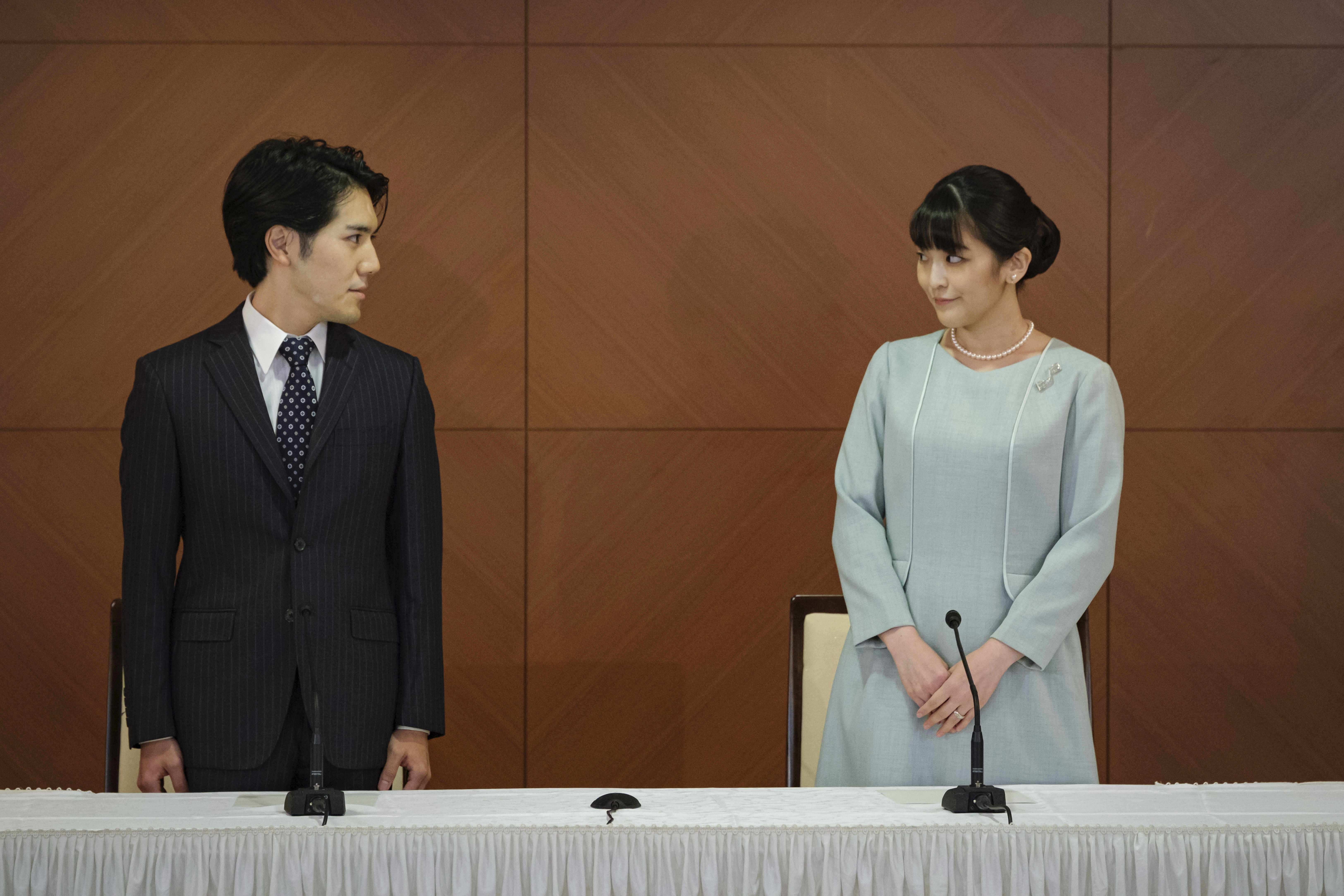 Japan's former Princess Mako, with her husband Kei Komuro, pose during a press conference to announce their marriage.