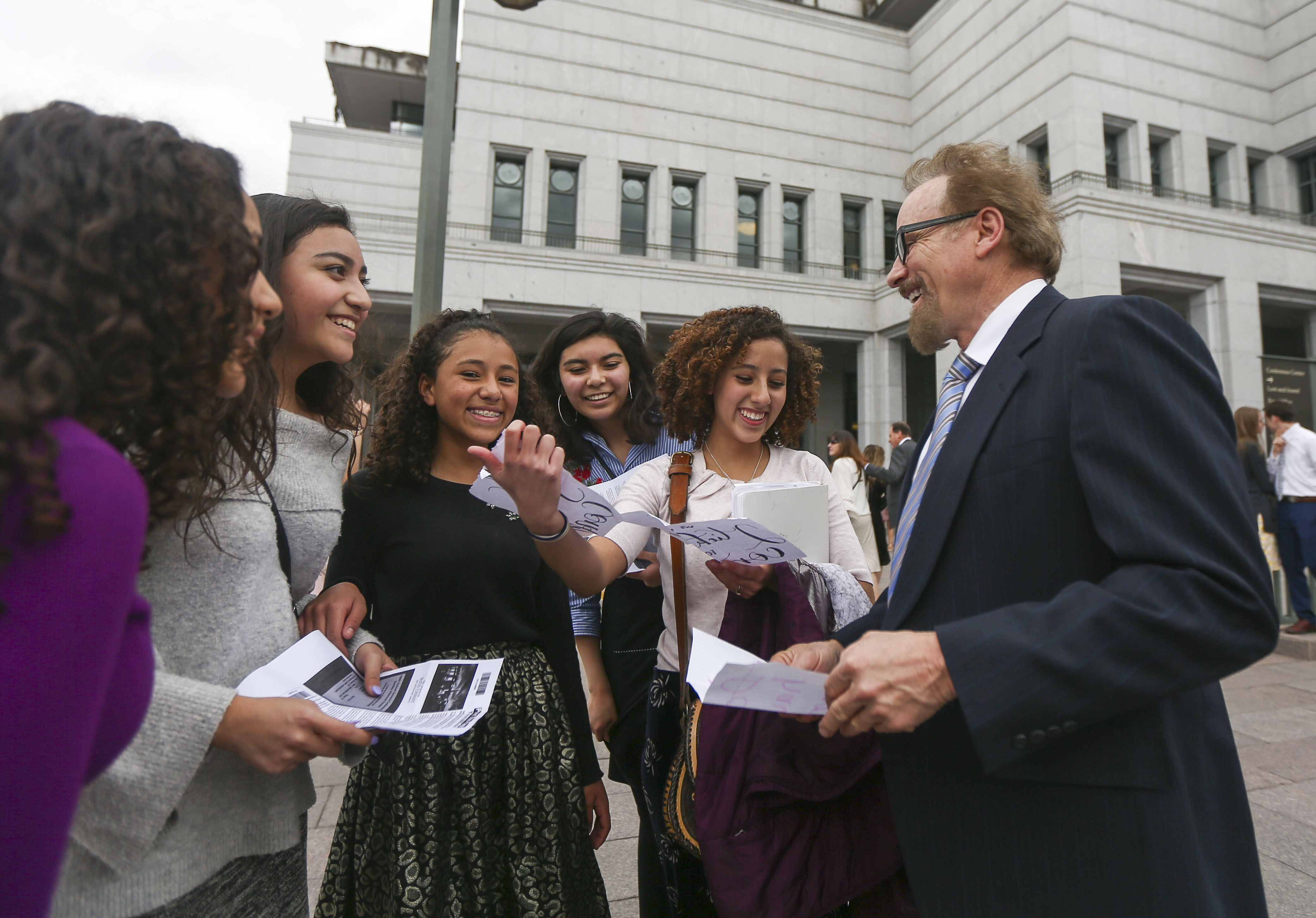 Members of The Church of Jesus Christ of Latter-day Saints celebrate receiving tickets to general conference in April 2019.