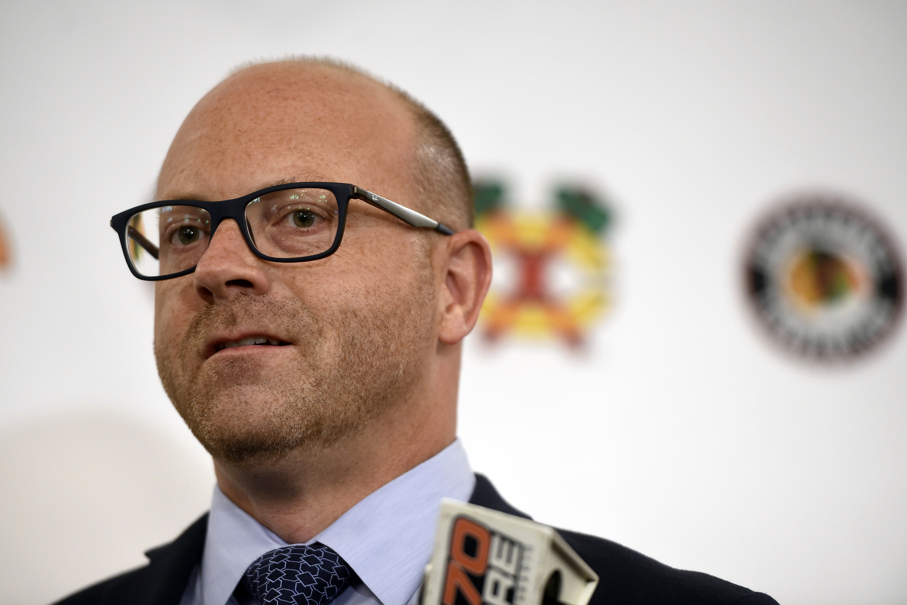 FILE - In this July 27, 2018, file photo, Chicago Blackhawks general manager Stan Bowman speaks to the media during the NHL hockey team's convention in Chicago.