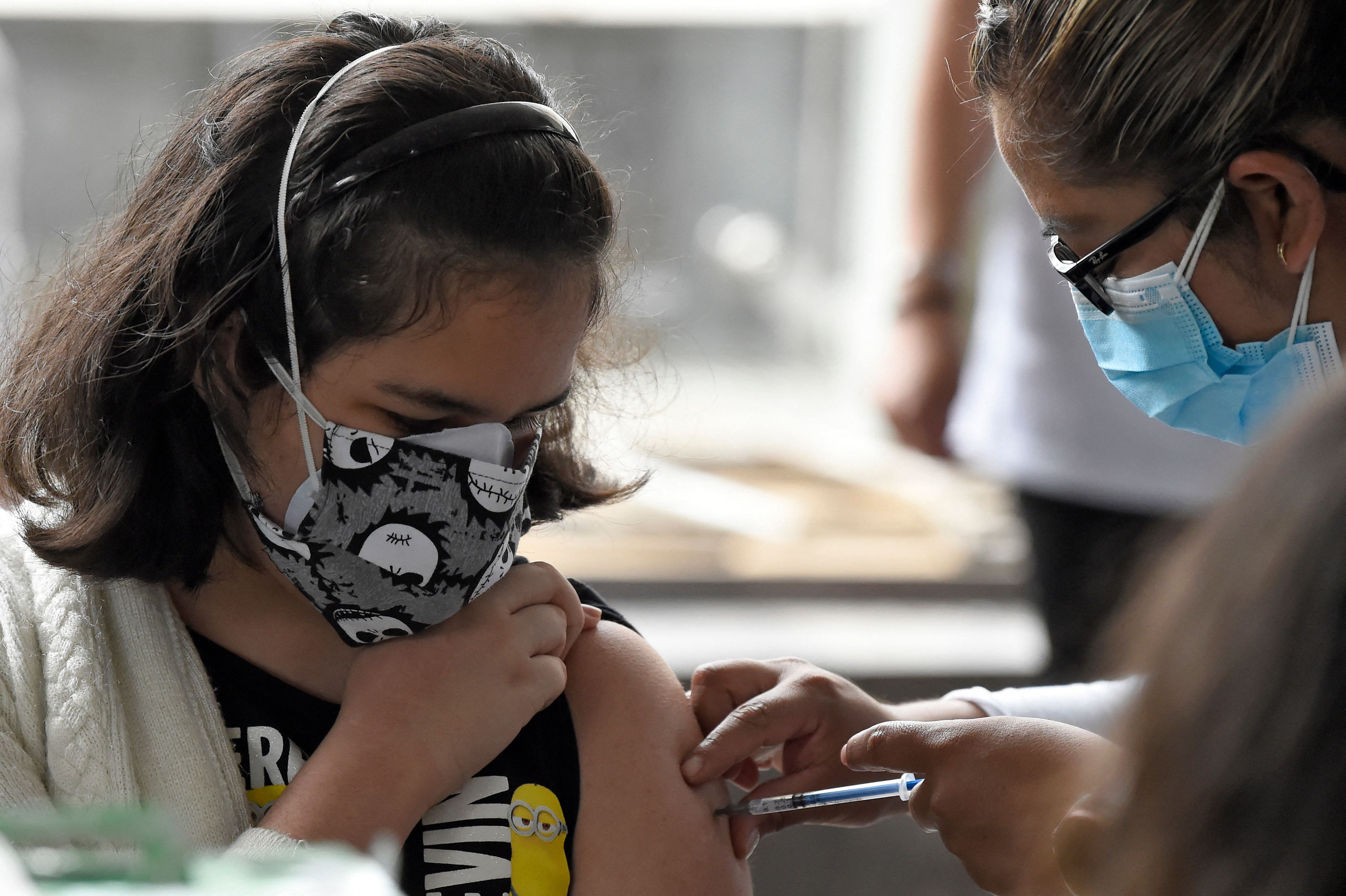 A minor is inoculated with the first dose of the Pfizer-BioNtech vaccine in Mexico City on Monday.