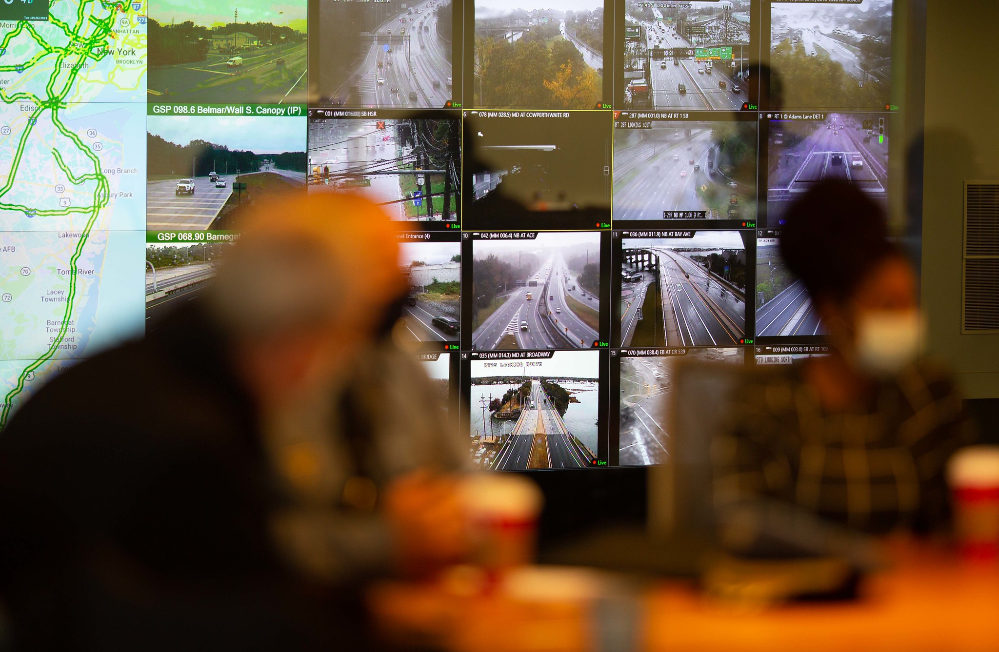 Multiple monitors show images of traffic on roads and highways at the NJ Statewide Traffic Management Center.