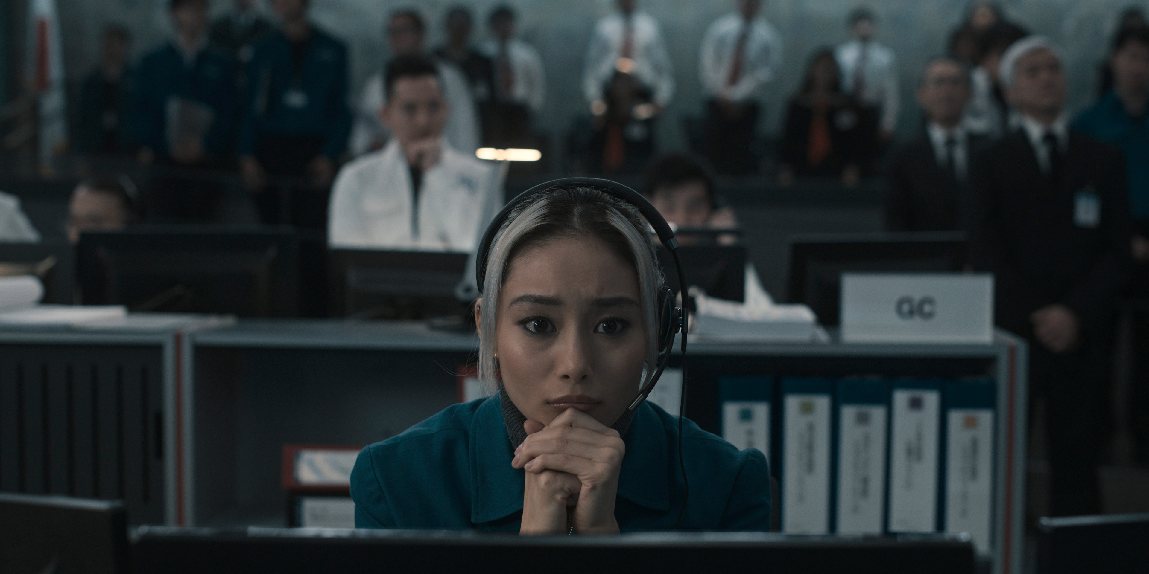Mitsuki Yamato, a control room employee in the Japanese space program, sits nervously at her station in the Apple TV Plus show Invasion.