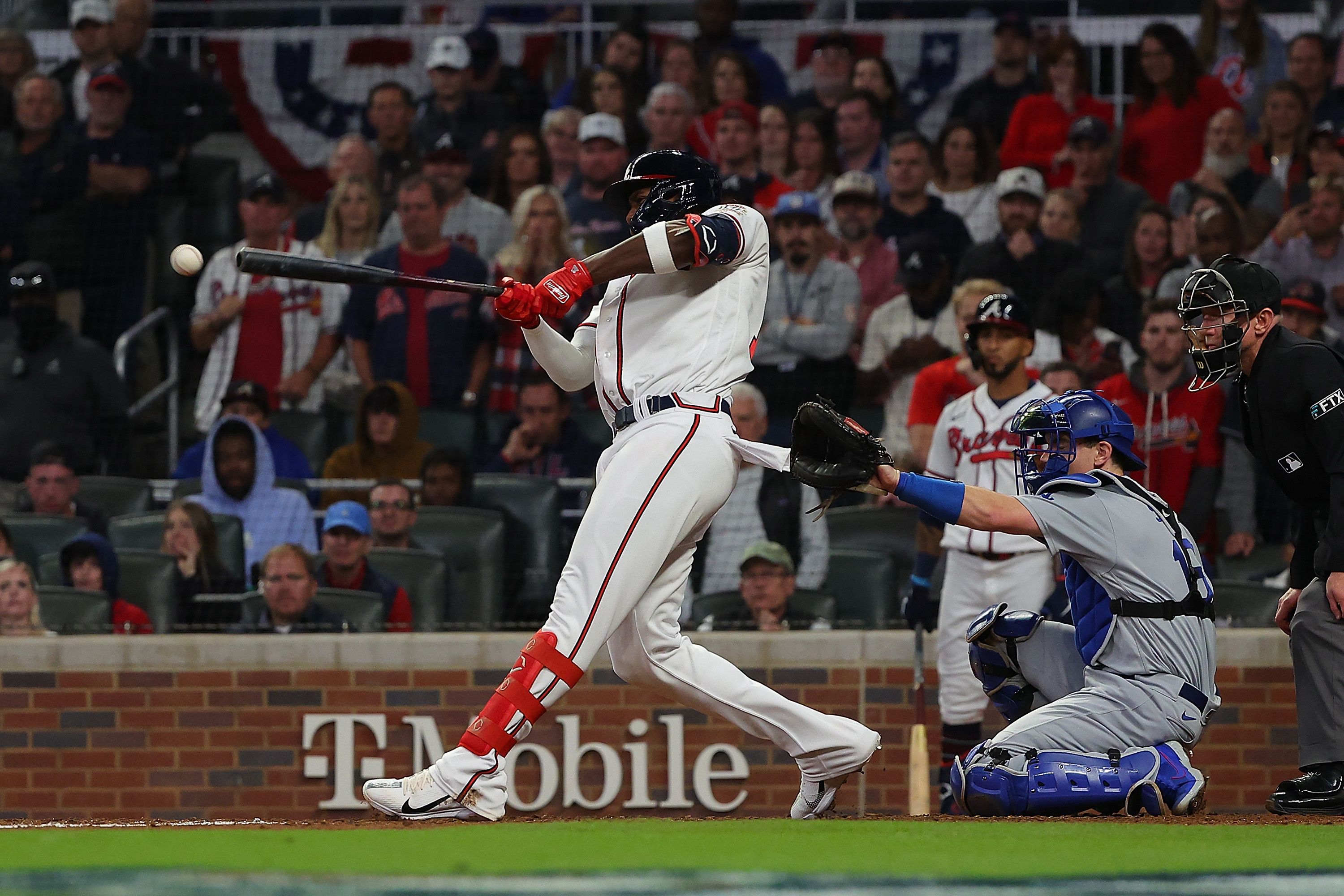 Jorge Soler #12 of the Atlanta Braves hits a double during the eighth inning of Game Six of the National League Championship Series against the Los Angeles Dodgers at Truist Park on October 23, 2021 in Atlanta, Georgia.