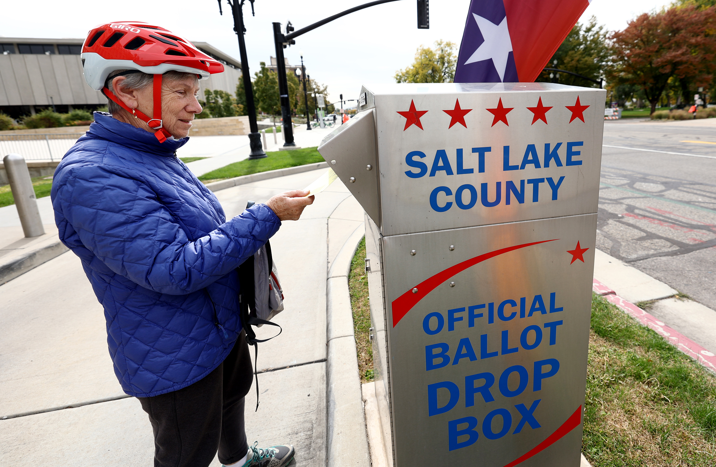 Marjorie Stolhand deposits her ballot in a drop box at the Salt Lake City Public Library in Salt Lake City on Oct. 18, 2021.