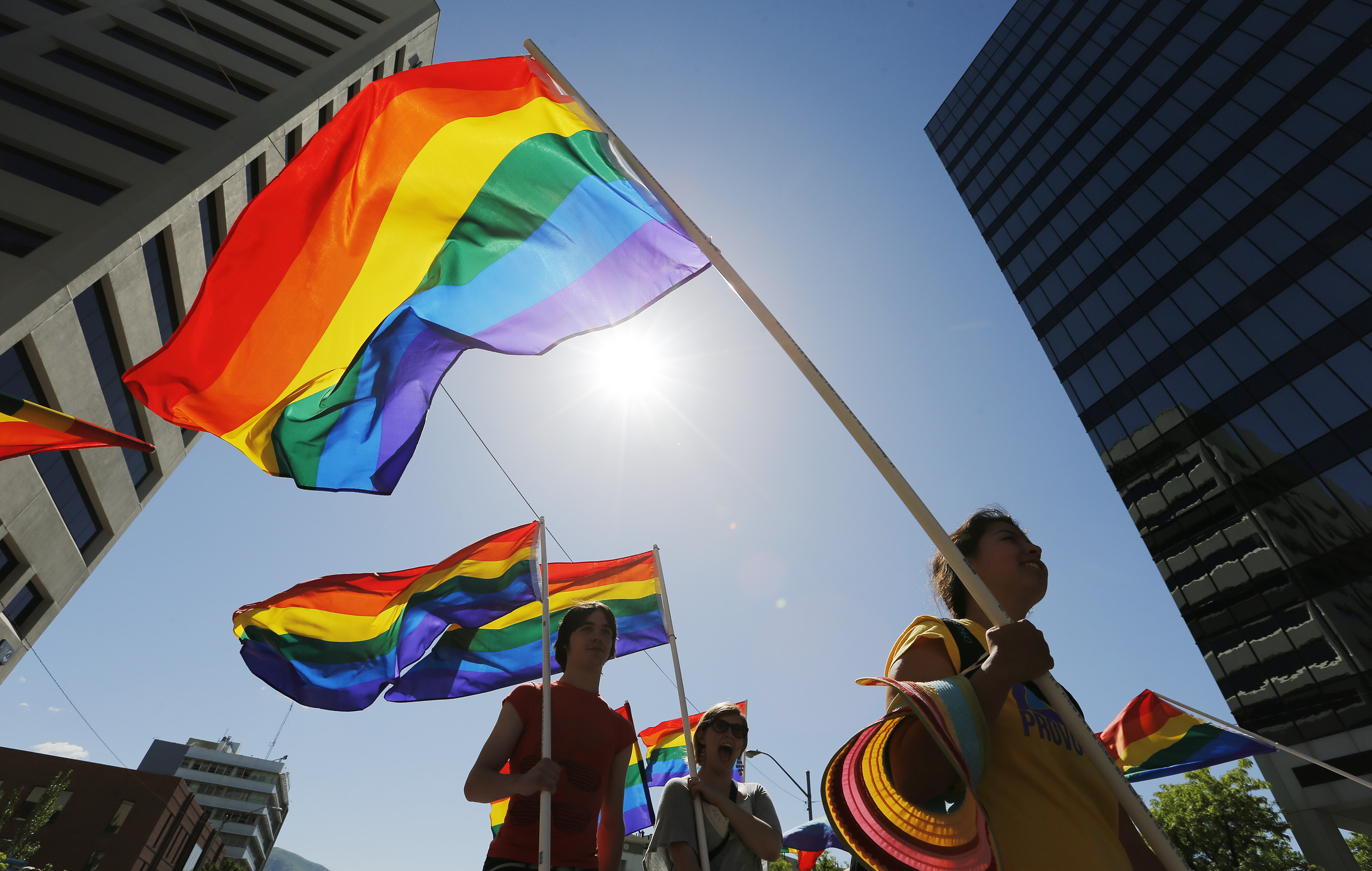 Flags are carried during Utah Pride Festival Parade in Salt Lake City Sunday, June 8, 2014.