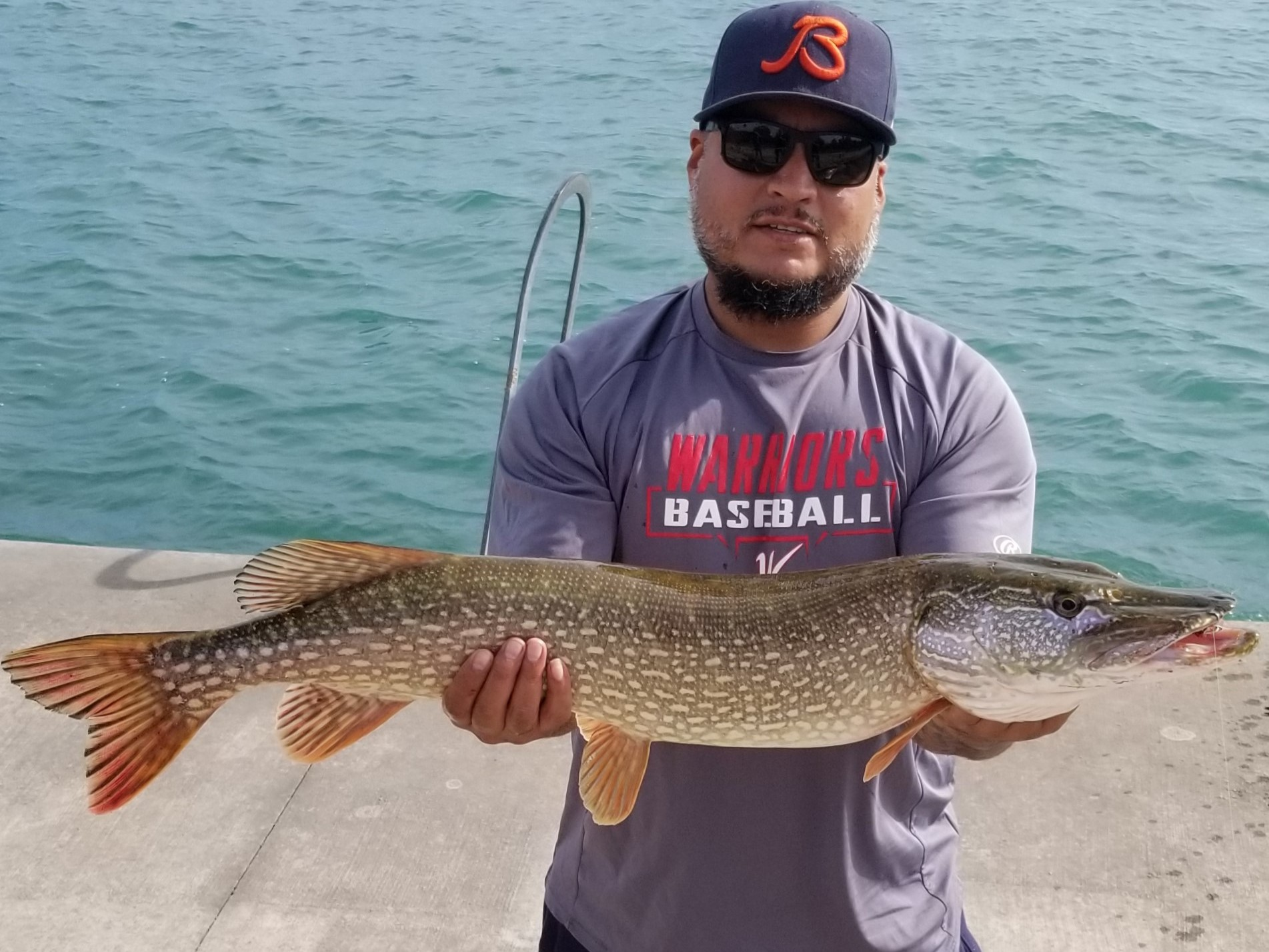 Sal Macais with the good northern pike he caught and released on the Chicago lakefront. Provided photo