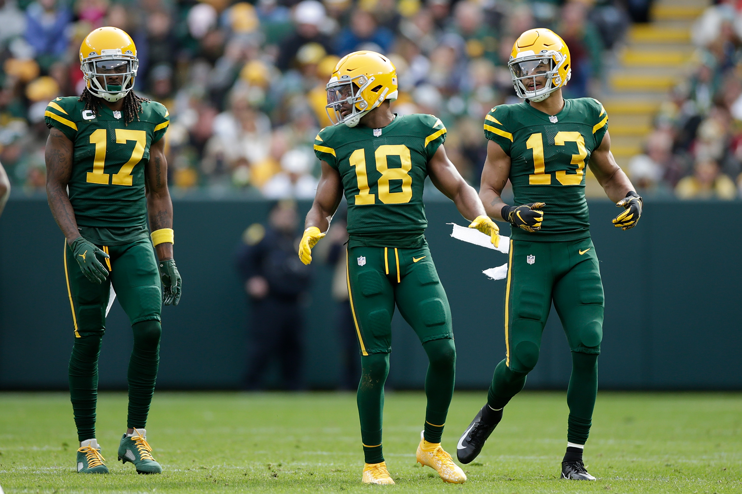 Davante Adams #17, Randall Cobb #18 and Allen Lazard #13 of the Green Bay Packers line up before the snap against the Washington Football Team at Lambeau Field on October 24, 2021 in Green Bay, Wisconsin. Green Bay defeated Washington 24-10.