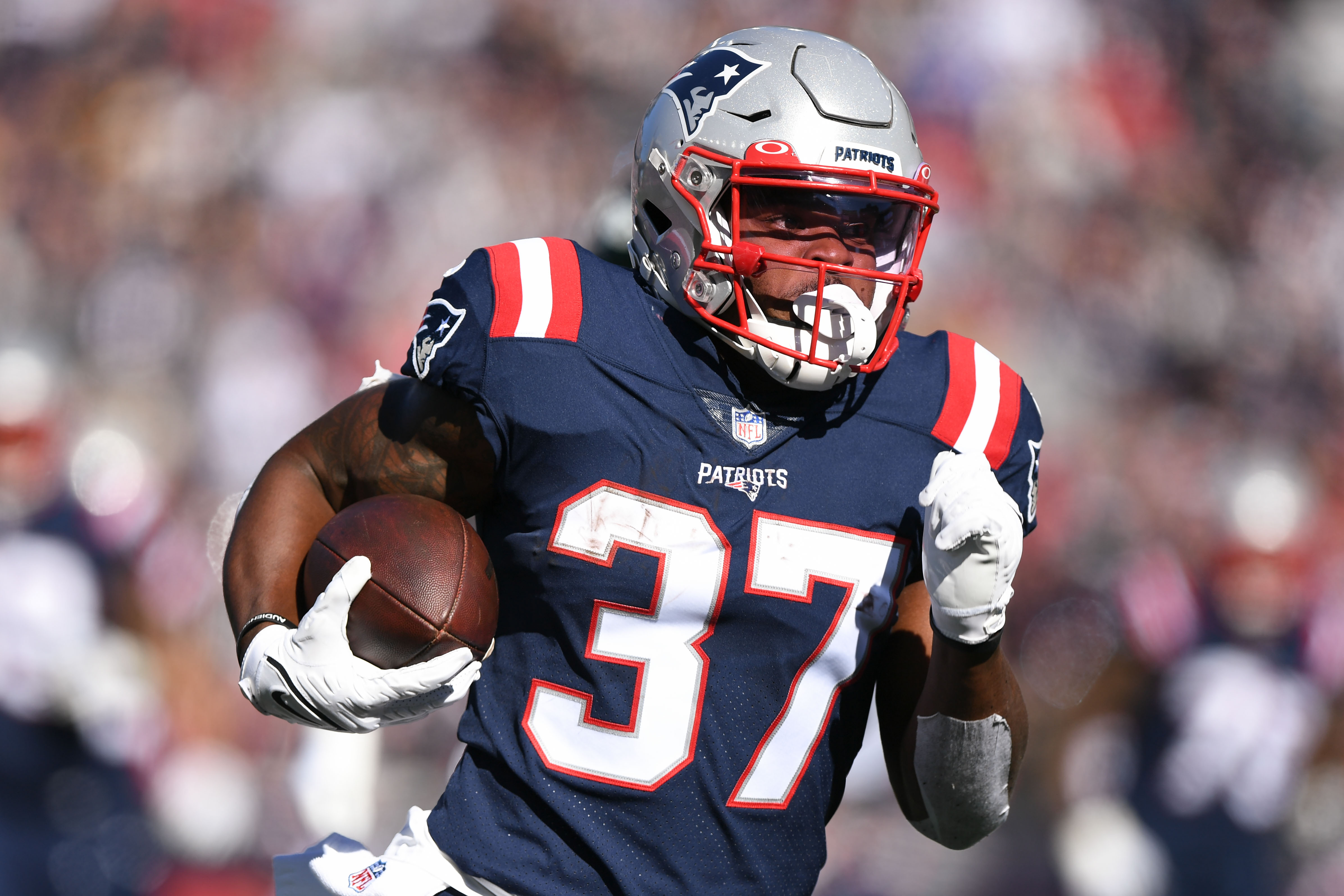 New England Patriots running back Damien Harris (37) runs with the ball during the first half against the New York Jets at Gillette Stadium.