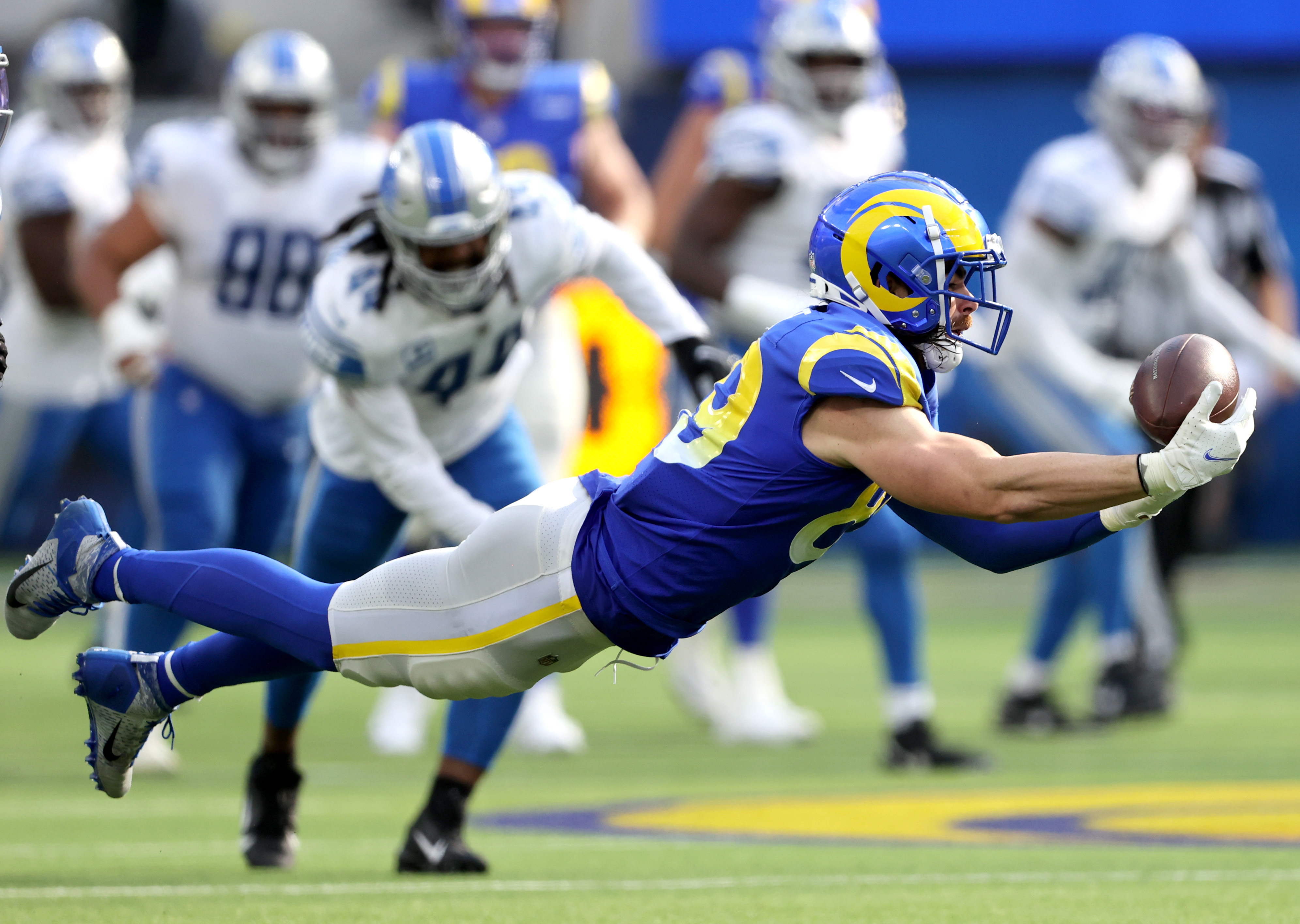 Tyler Higbee #89 of the Los Angeles Rams catches the ball during the second half in the game against the Detroit Lions at SoFi Stadium on October 24, 2021 in Inglewood, California.