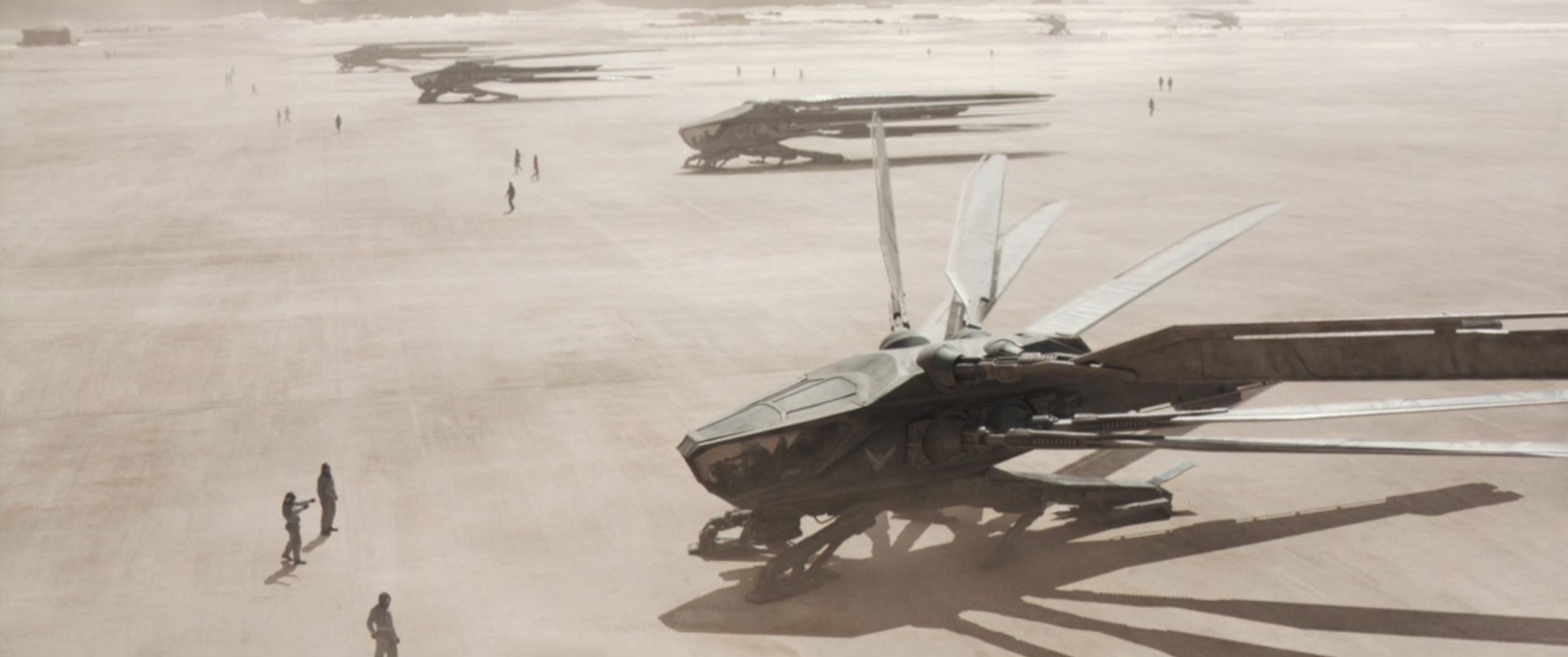 A thopter spools up on the Atreides flight line in Dune.