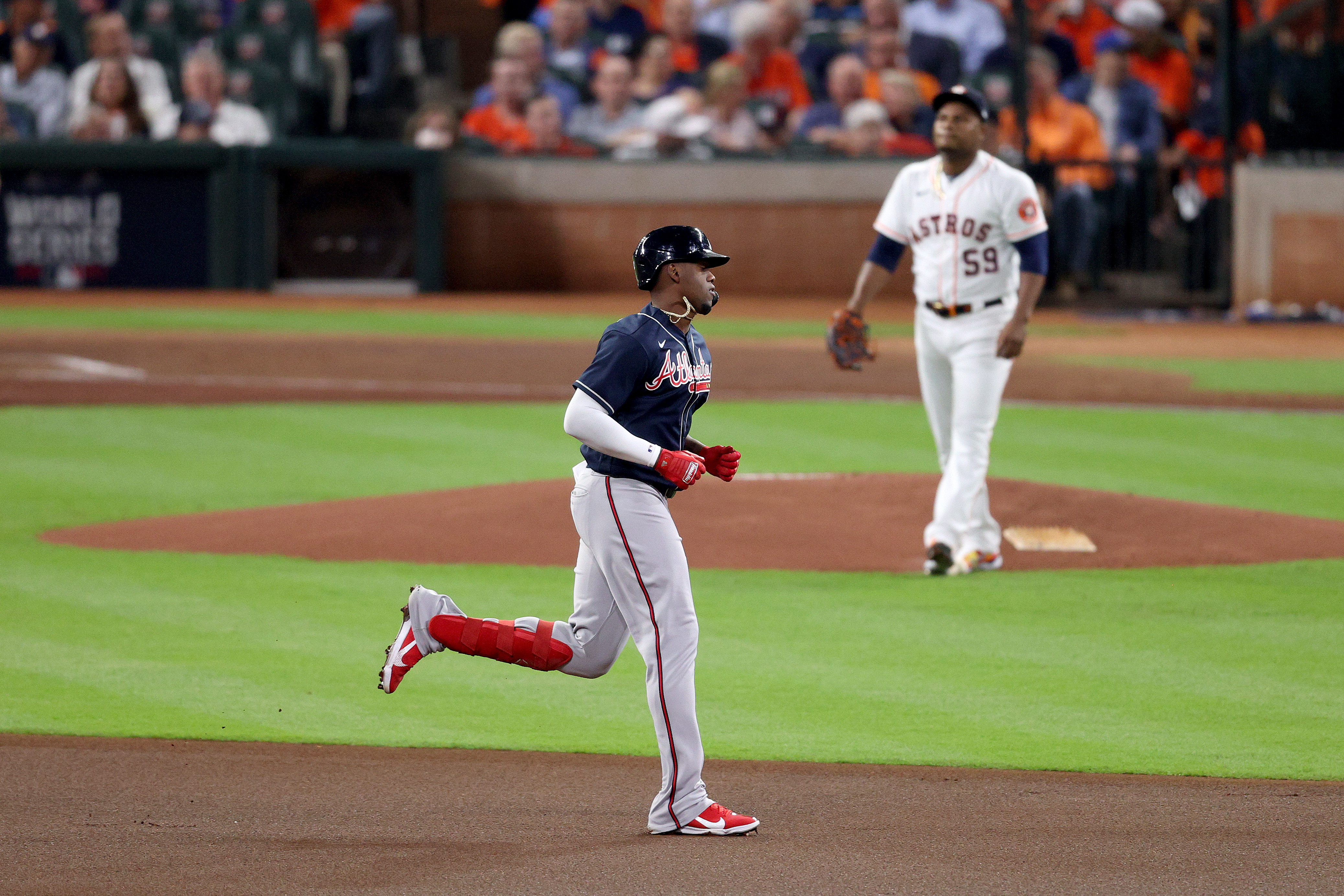 Jorge Soler #12 of the Atlanta Braves rounds the bases after hitting a solo home run against Framber Valdez #59 of the Houston Astros during the first inning in Game One of the World Series at Minute Maid Park on October 26, 2021 in Houston, Texas.