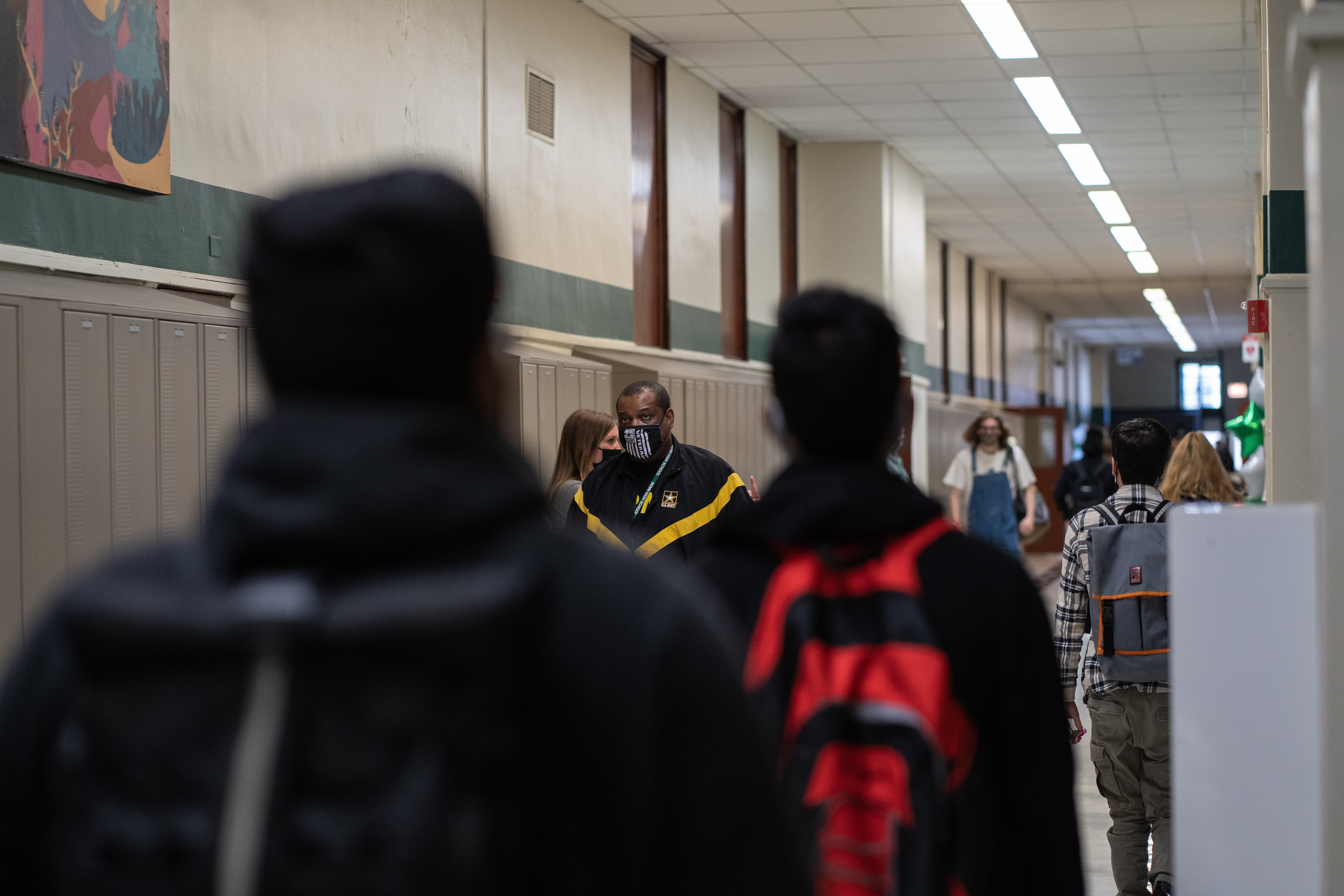 Students and staff walk the halls of Senn High School on the first week back to classrooms on April 23, 2021.