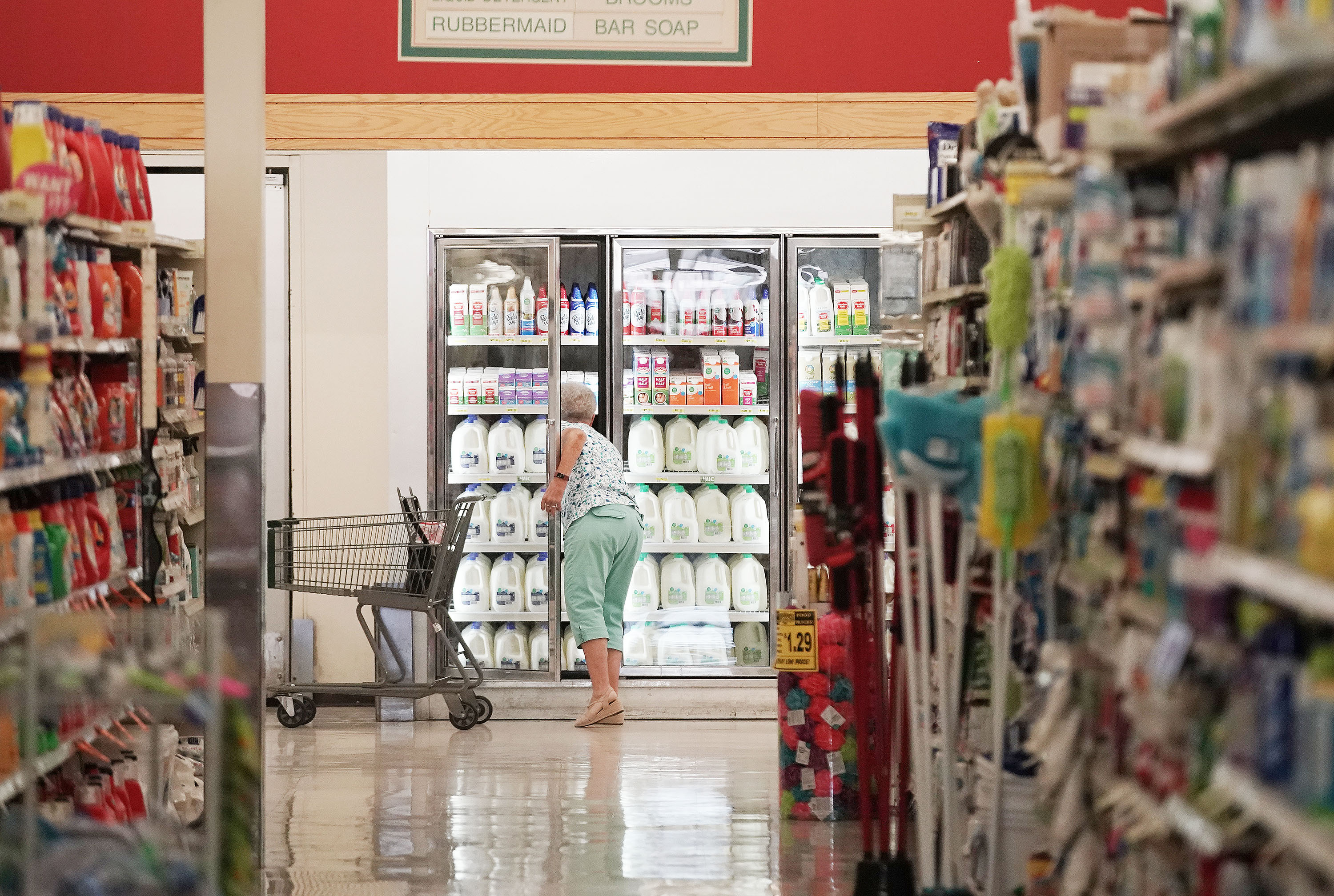 A shopper looks at milk at Reams in Sandy last July.
