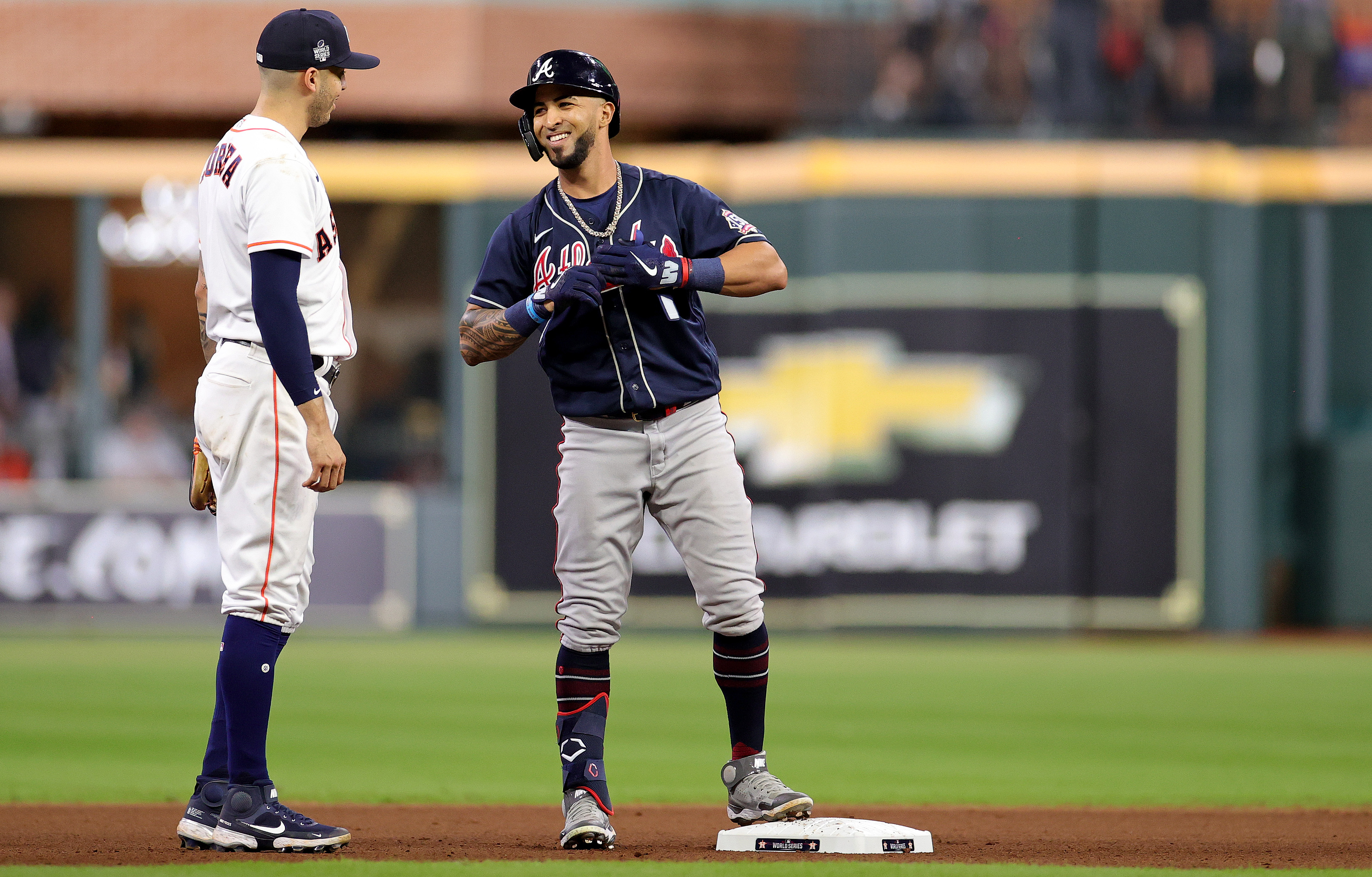 Eddie Rosario #8 of the Atlanta Braves hits a double against the Houston Astros during the seventh inning in Game One of the World Series at Minute Maid Park on October 26, 2021 in Houston, Texas.
