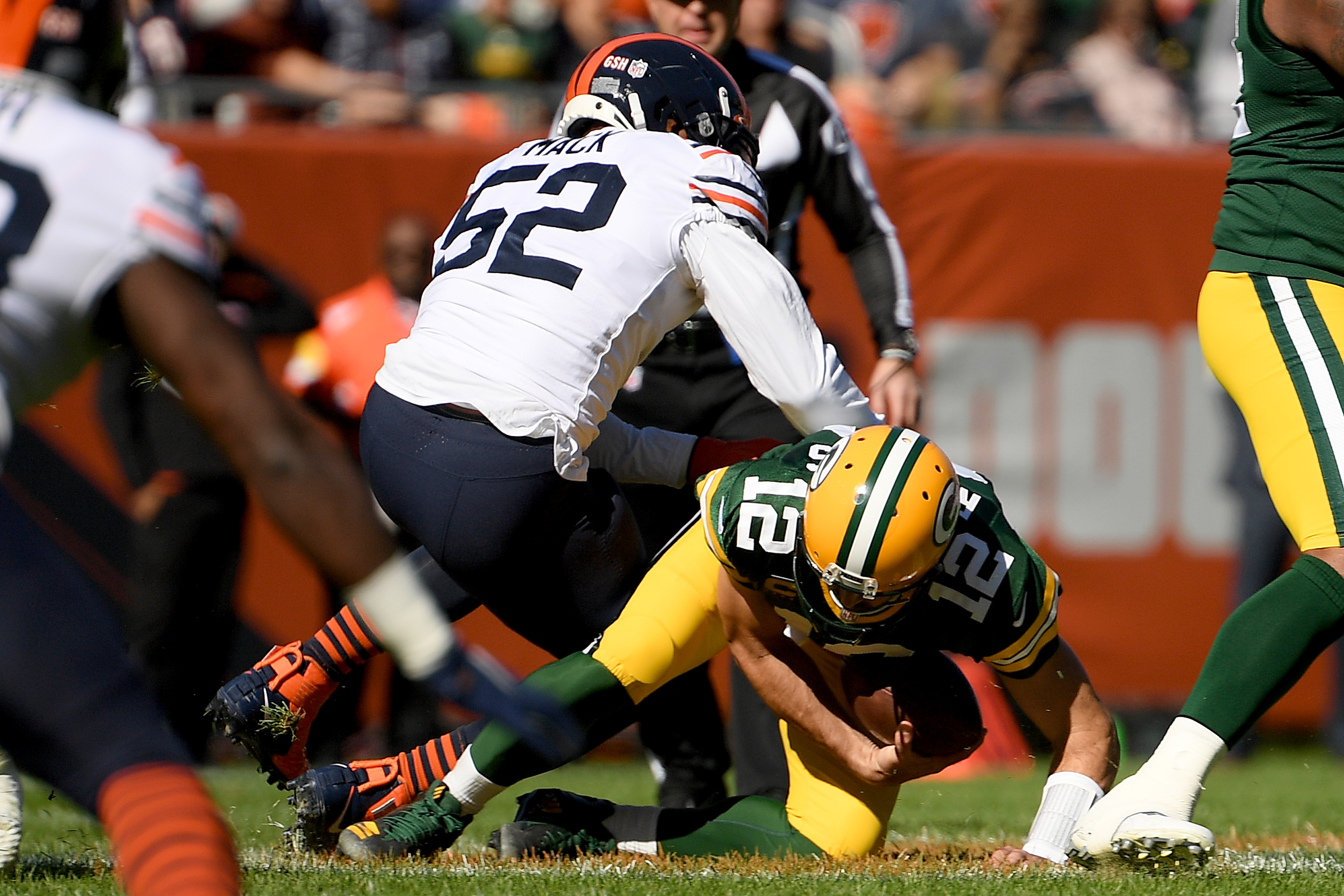 Aaron Rodgers #12 of the Green Bay Packers is sacked by Khalil Mack #52 of the Chicago Bears in the first quarter at Soldier Field on October 17, 2021 in Chicago, Illinois.