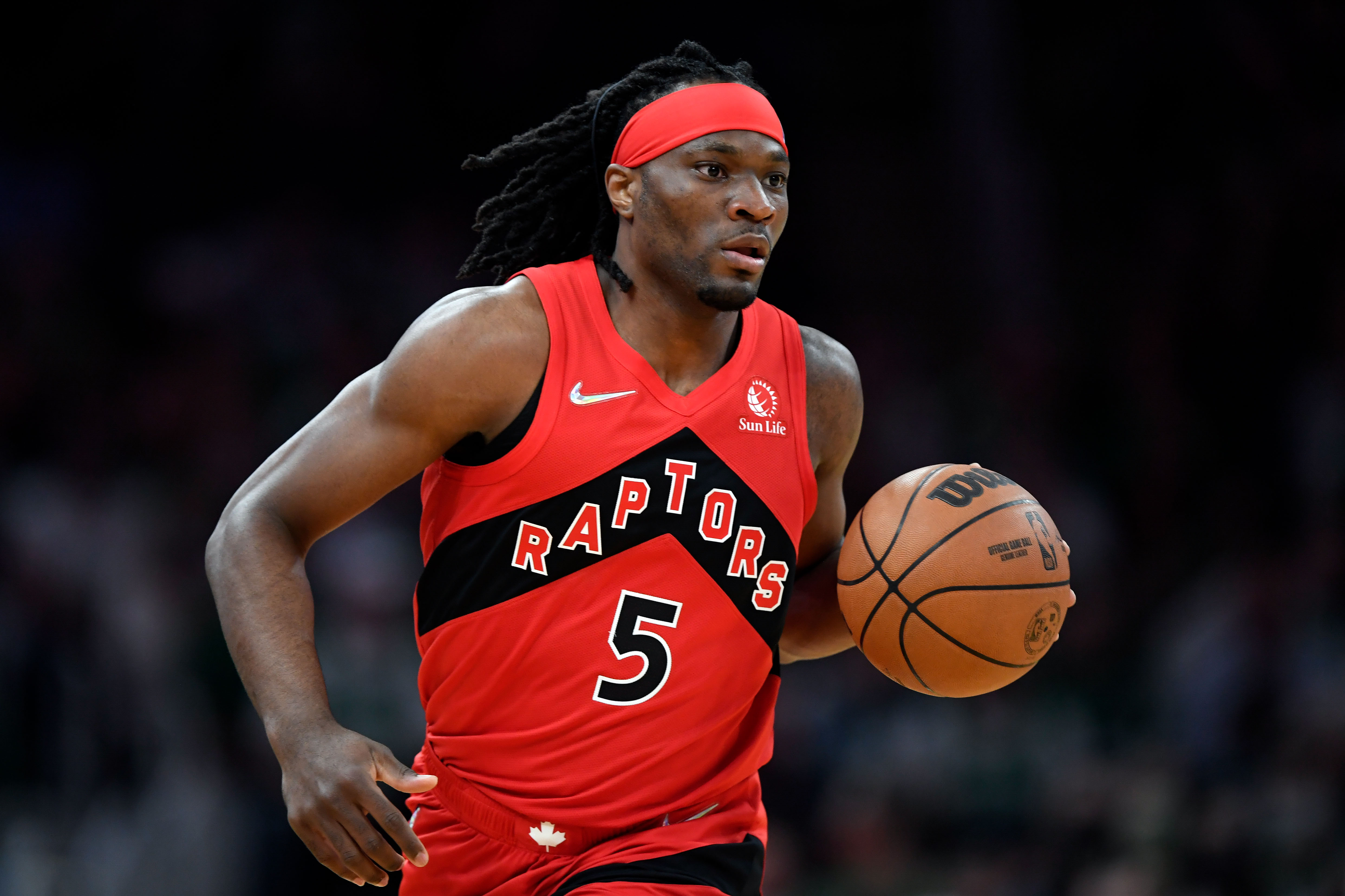 Toronto Raptors forward Precious Achiuwa (5) dribbles the ball during the first half of a game against the Boston Celtics at the TD Garden.