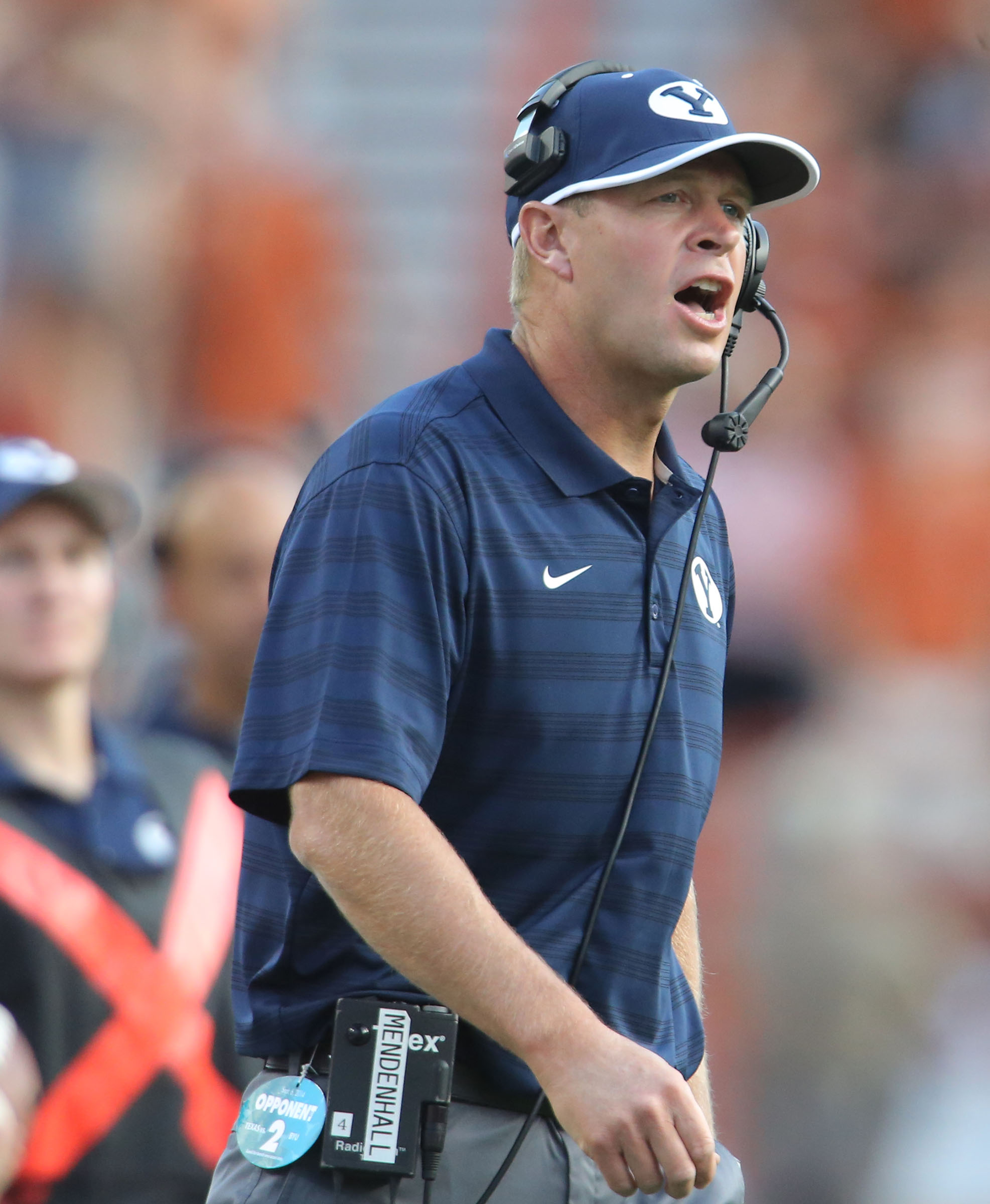 BYU coach Bronco Mendenhall calls out to a referee as BYU and Texas play Saturday, Sept. 6, 2014, in Austin, Texas.