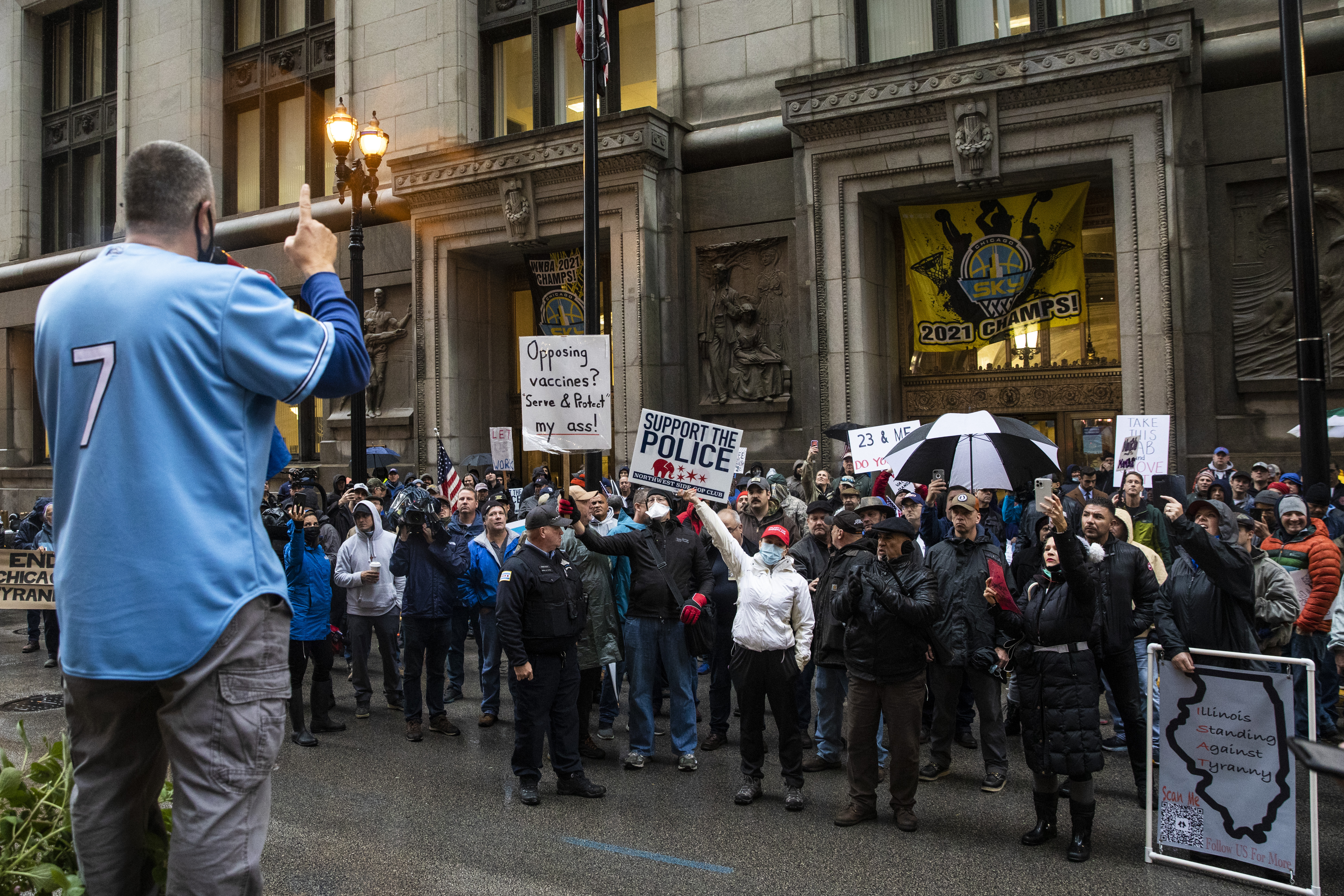 Fraternal Order of Police Lodge 7 President John Catanzara addresses a group of union protesters and their supporters as they rally against COVID-19 vaccine mandates outside City Hall before a Chicago City Council meeting, Monday morning, Oct. 25, 2021.