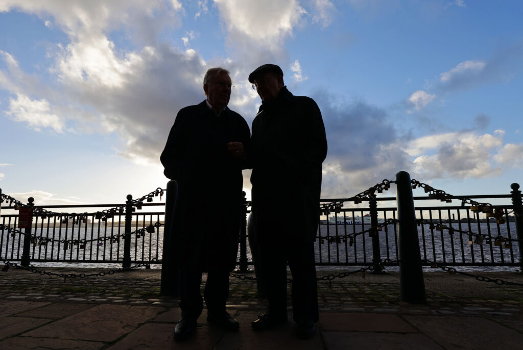 President M. Russell Ballard and Elder Quentin L. Cook of The Church of Jesus Christ of Latter-day Saints, walk along the Royal Albert Dock Liverpool in Liverpool on Monday, Oct. 25, 2021. 19th century Latter-day Saint converts immigrated to the United States from the docks.