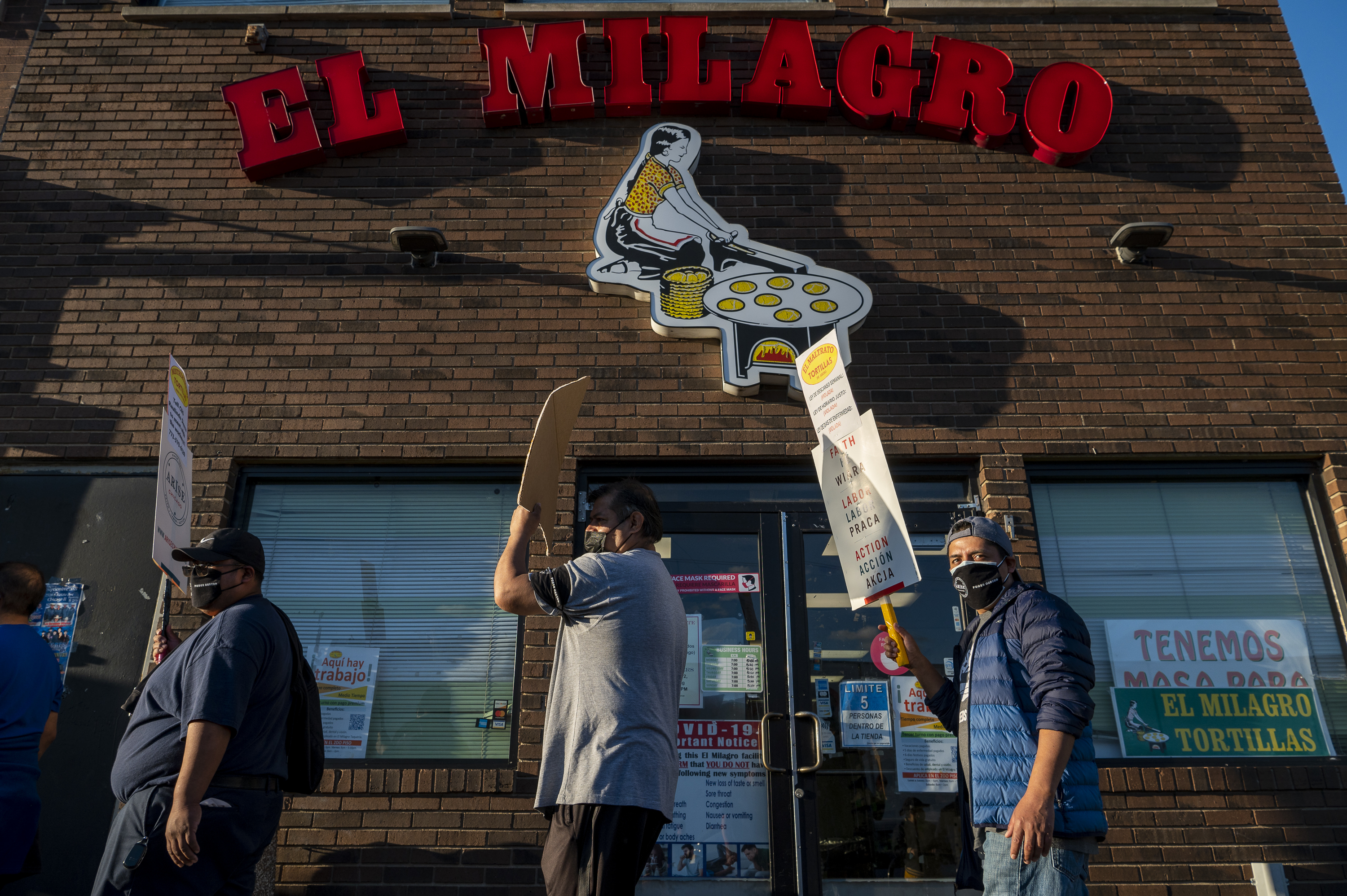 El Milagro workers strike in front of a company location at 3050 W. 26th St. on Sept. 24.
