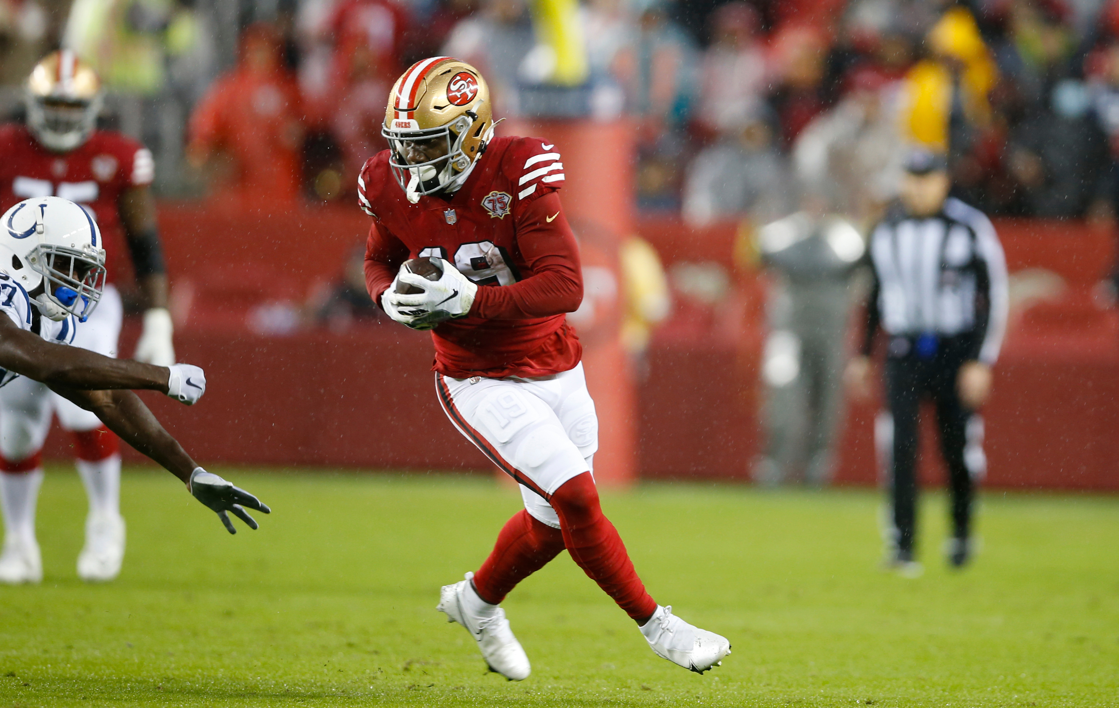 Deebo Samuel #19 of the San Francisco 49ers runs after making a catch during the game against the Indianapolis Colts at Levi's Stadium on October 24, 2021 in Santa Clara, California.