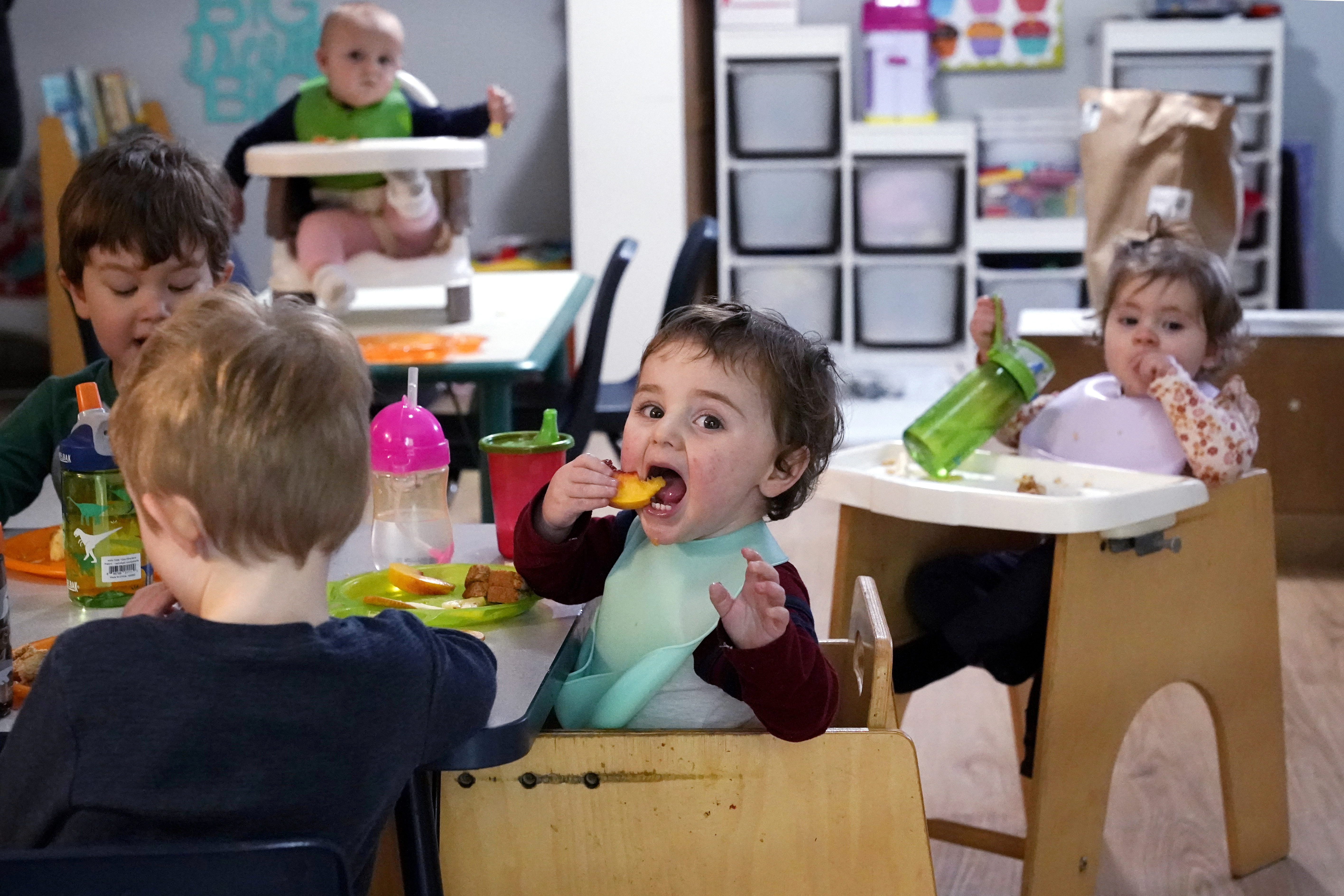 """Kids eat lunch at Forever Young Daycare in the Seattle suburb of Mountlake Terrace. Owner Amy McCoy has had to do more of the child care work herself after being unable for half of this year to find a new assistant for her in-home child care who would accept the $16-an-hour pay for the entry-level job. """"Nobody wants to work for what I can afford to pay right now,"""" McCoy said."""