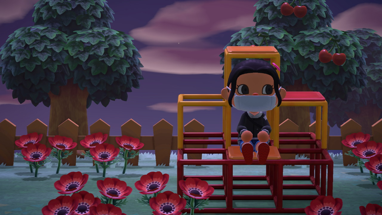 An Animal Crossing character sits on a jungle gym at night