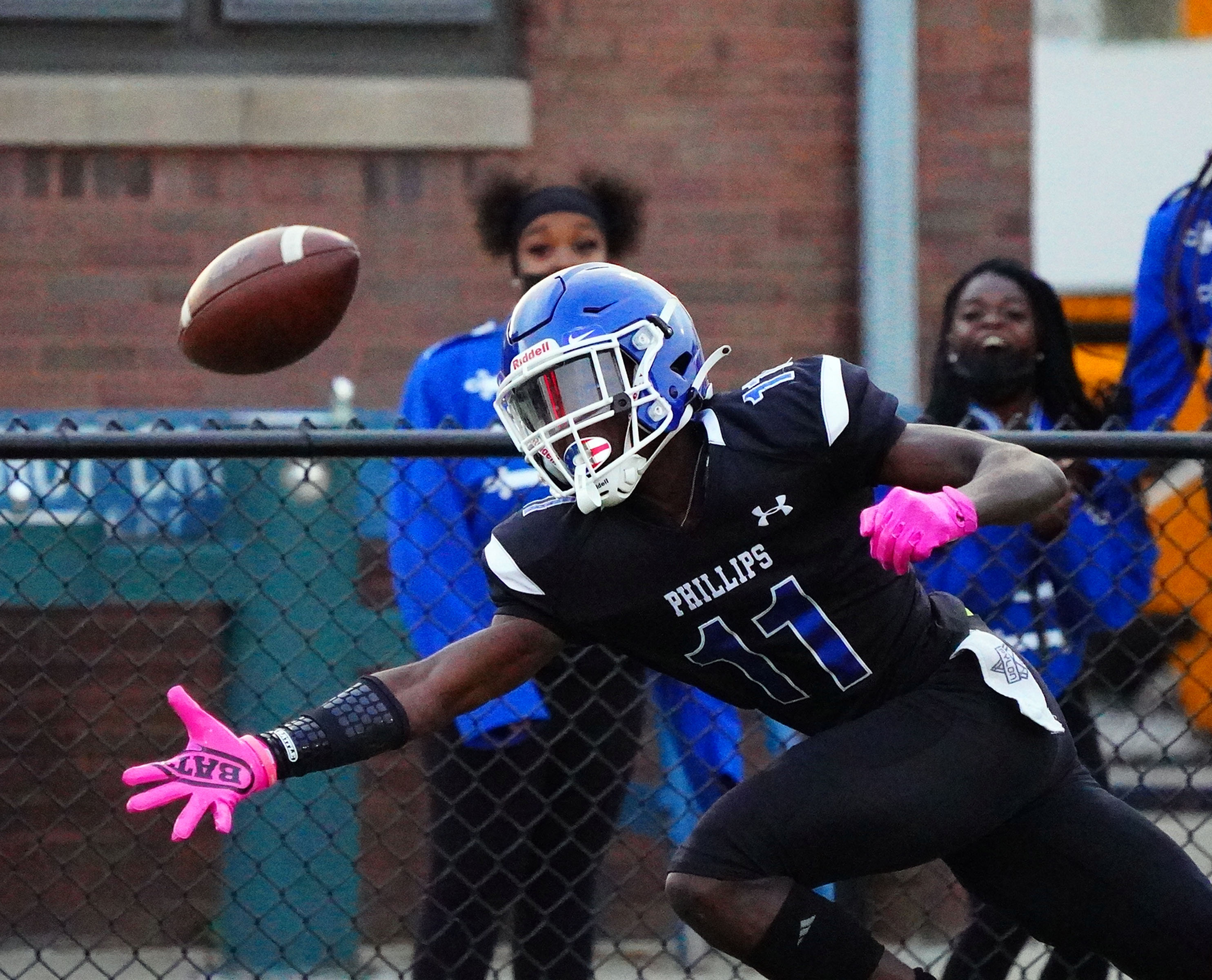 The ball is just out of reach for Phillips's Kyerre Howard (11) during their 14-12 win over Simeon at Gately Stadium