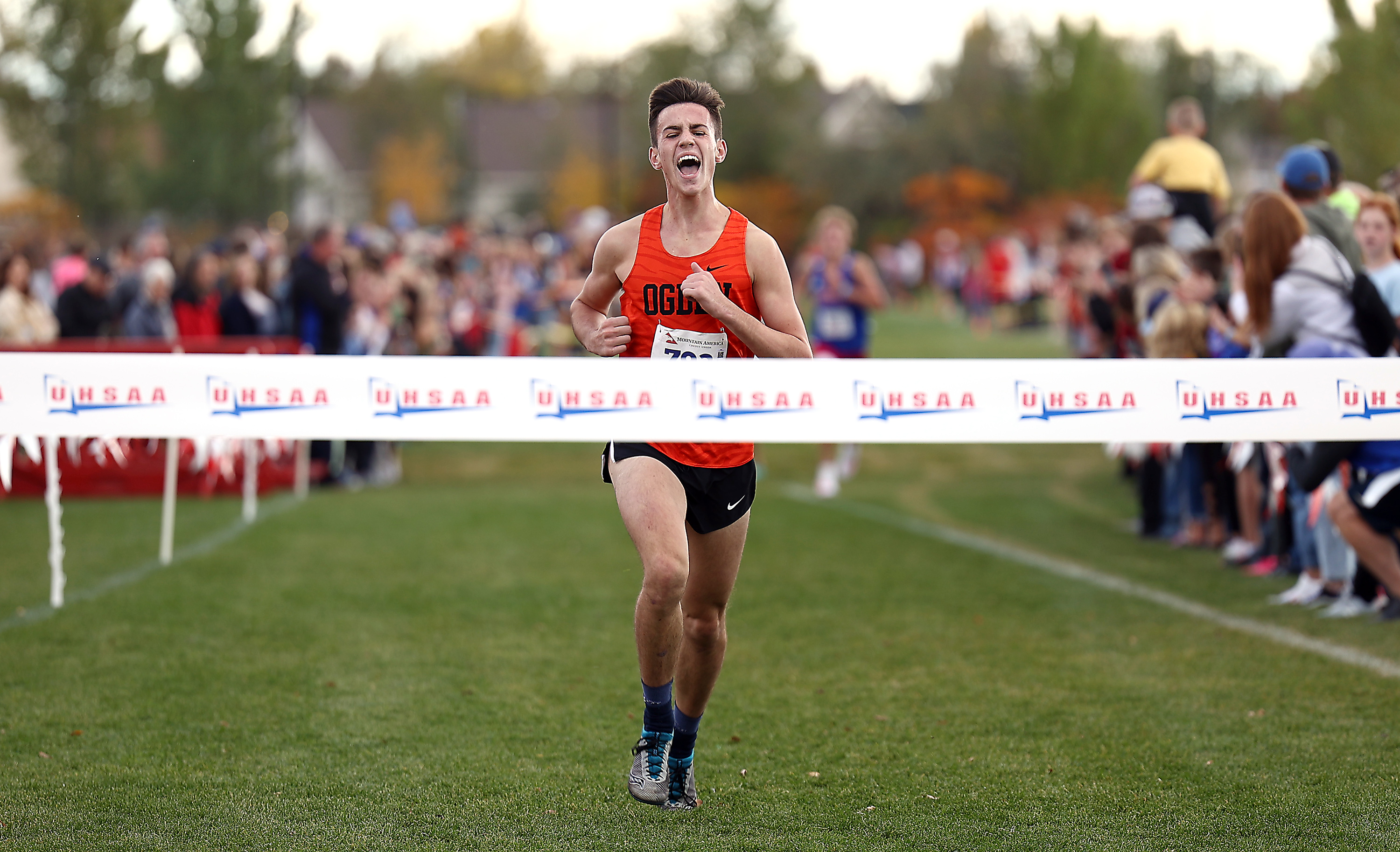 Ogden's Jack Blodgett, begins his celebration as he nears the tape as runners compete in the cross country state championships at the Regional Athletic Complex in Salt Lake City on Wednesday, Oct. 27, 2021.