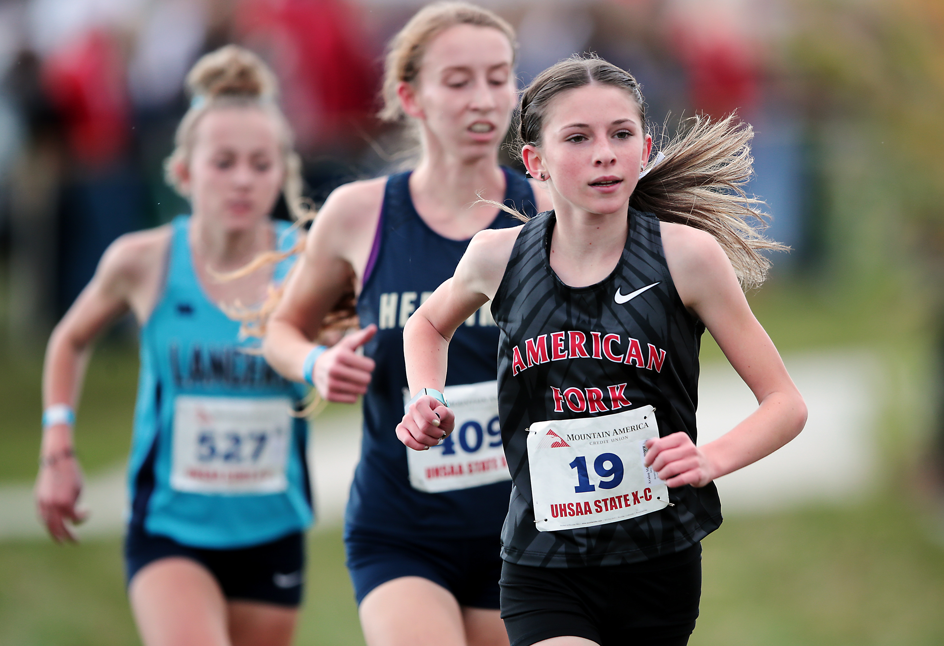 American Fork's Avalon Mecham looks ahead as she runs in the 6A girls cross-country state championship.