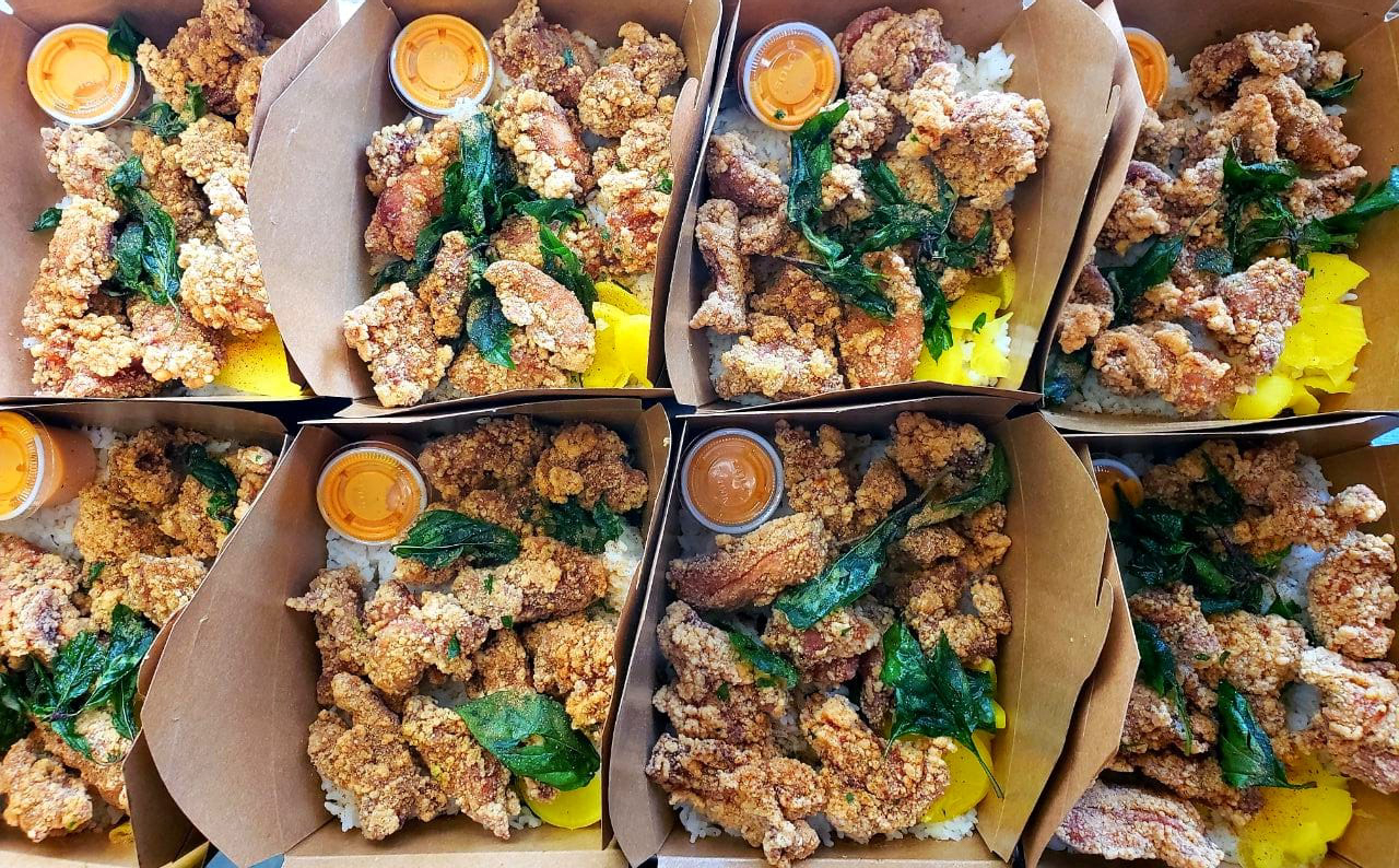 Cardboard boxes full of fried chicken.