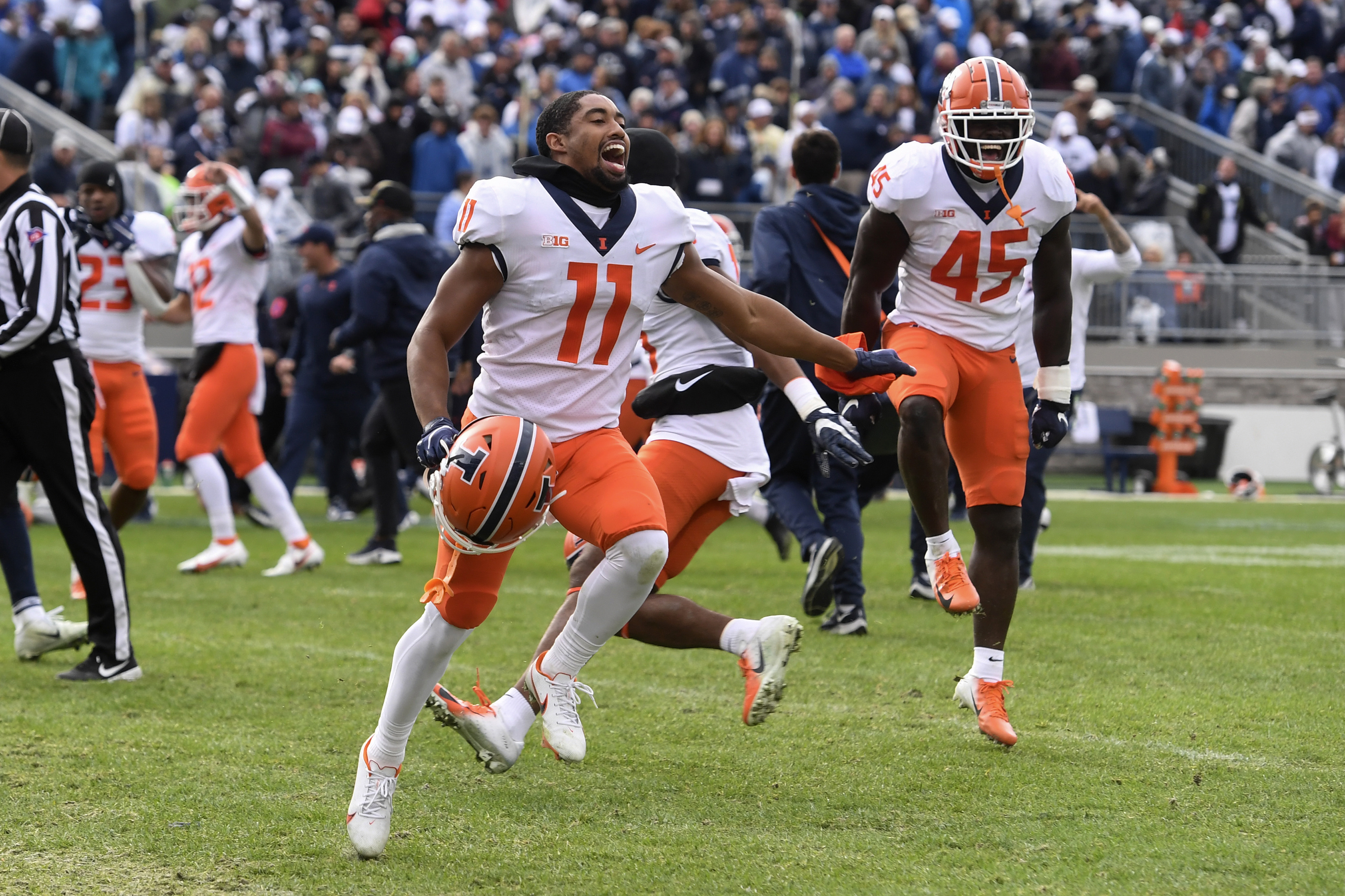 Illinois wide receiver Carlos Sandy (11) and linebacker Khalan Tolson (45) celebrate after last week's win over Penn State.