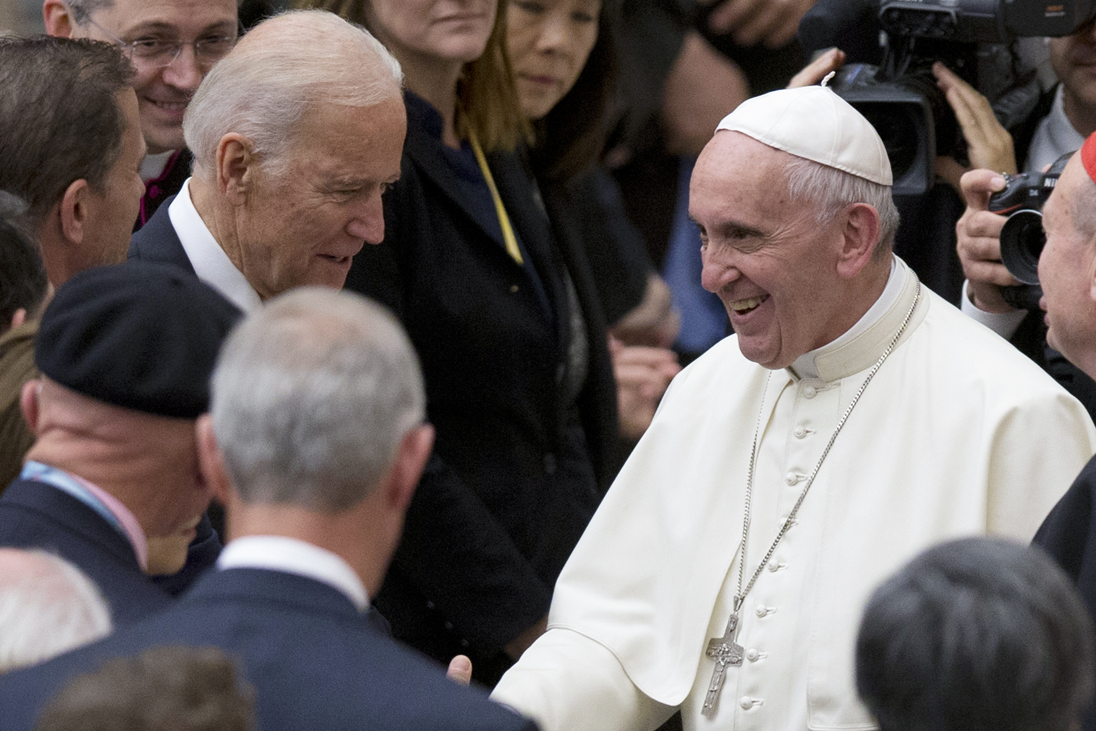 In this April 29, 2016, file photo Pope Francis shakes hands with Vice President Joe Biden at the Vatican.