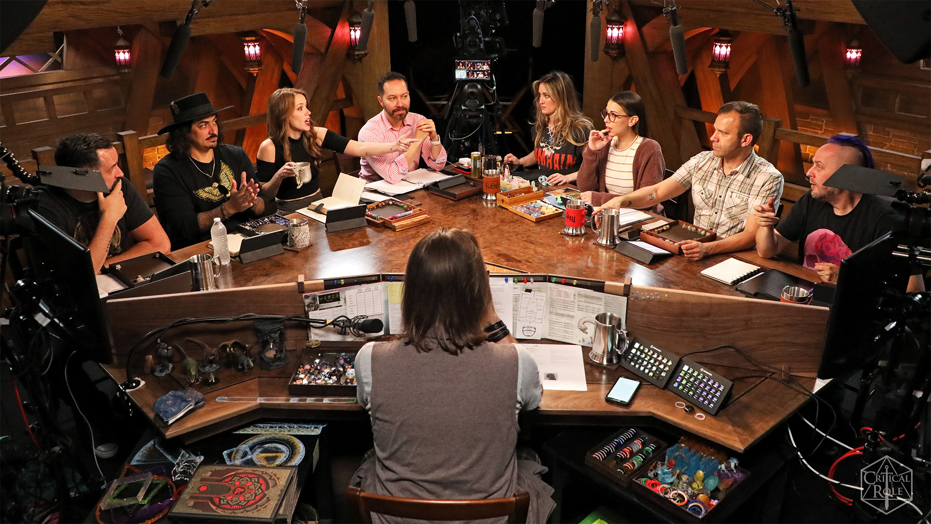 The full cast of Critical Role surrounded by the production crew.