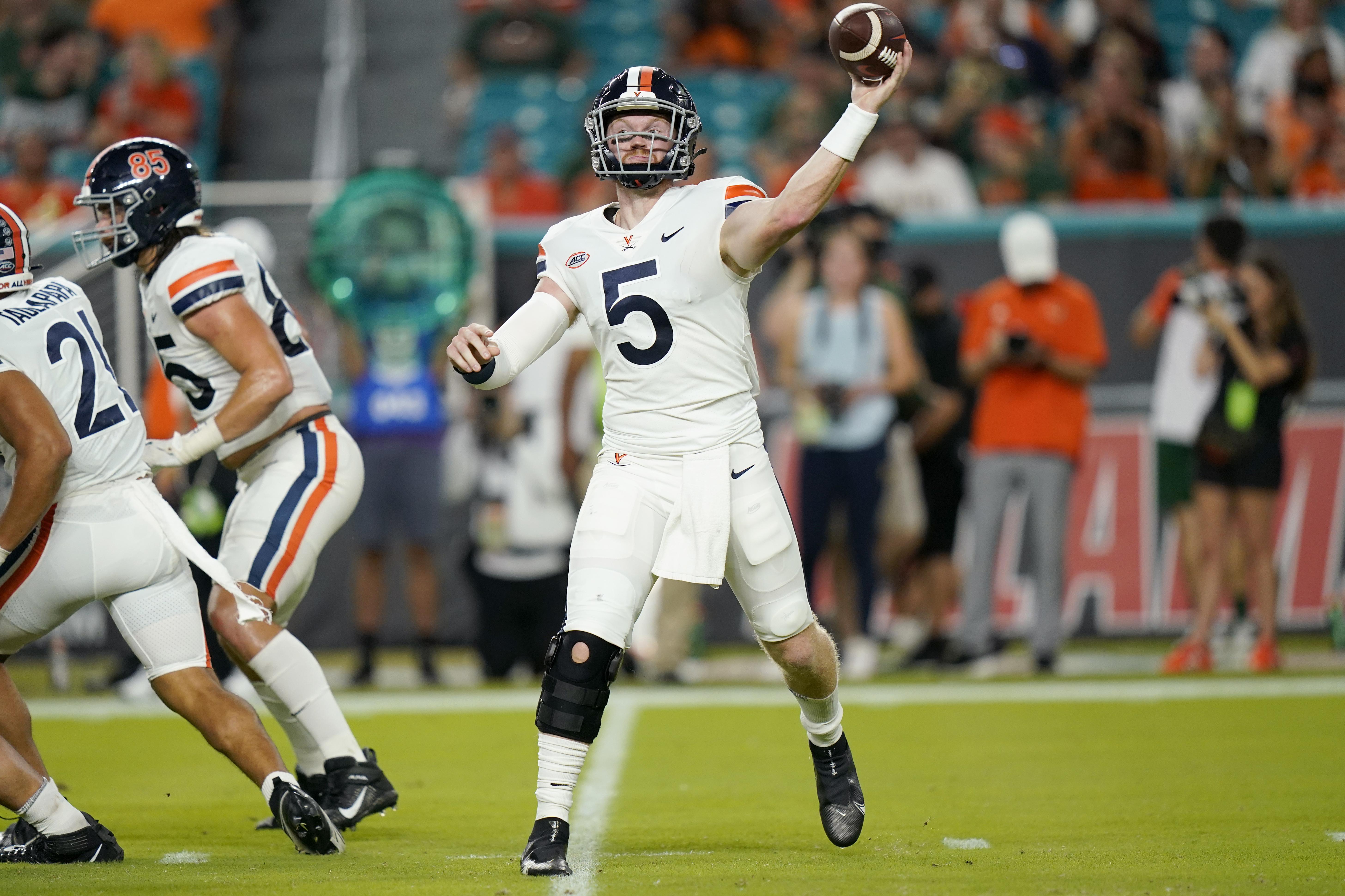 Virginia quarterback Brennan Armstrong passes during game against Miami, Thursday, Sept. 30, 2021, in Miami Gardens, Fla.