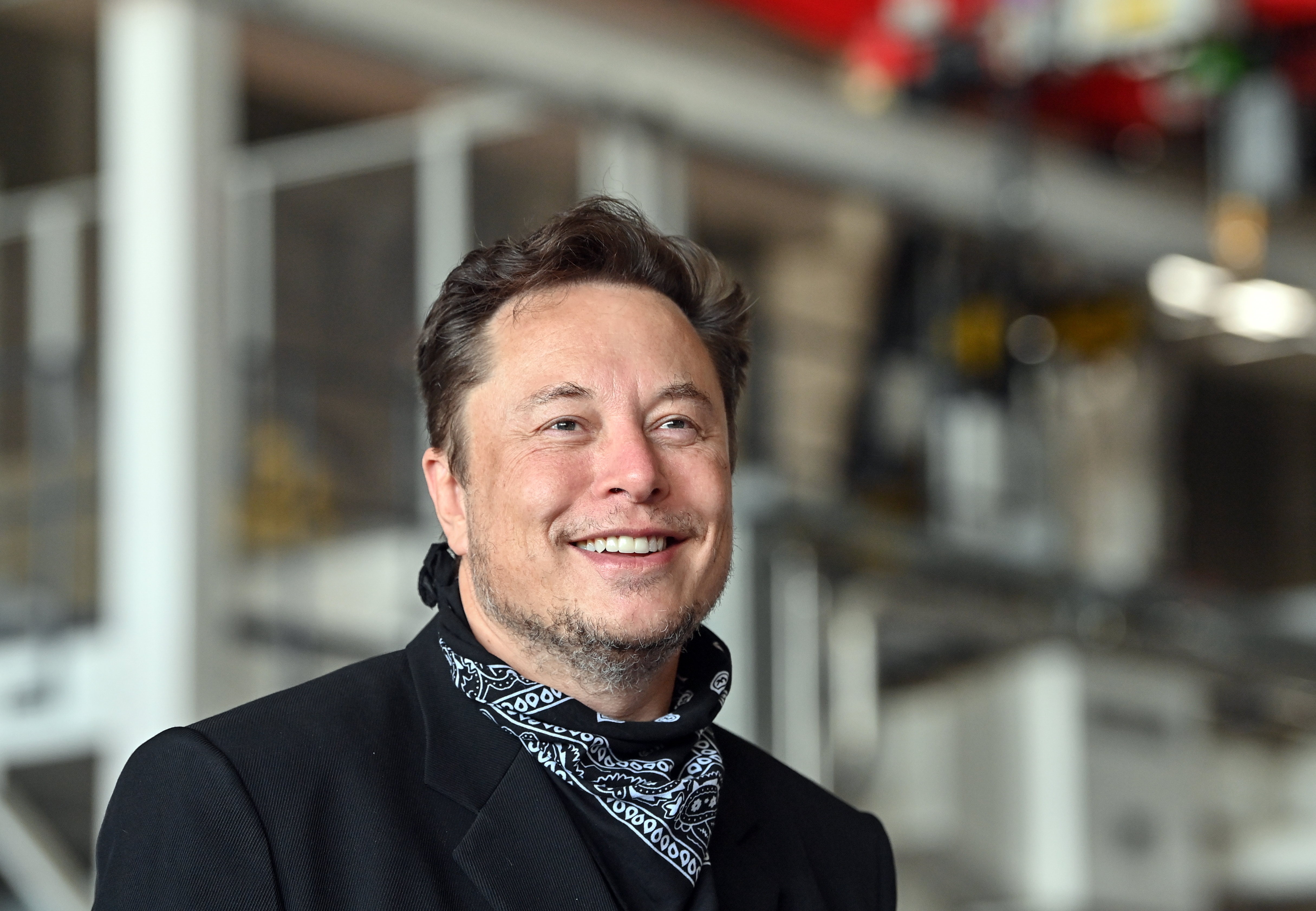 A photo of Elon Musk smiling.