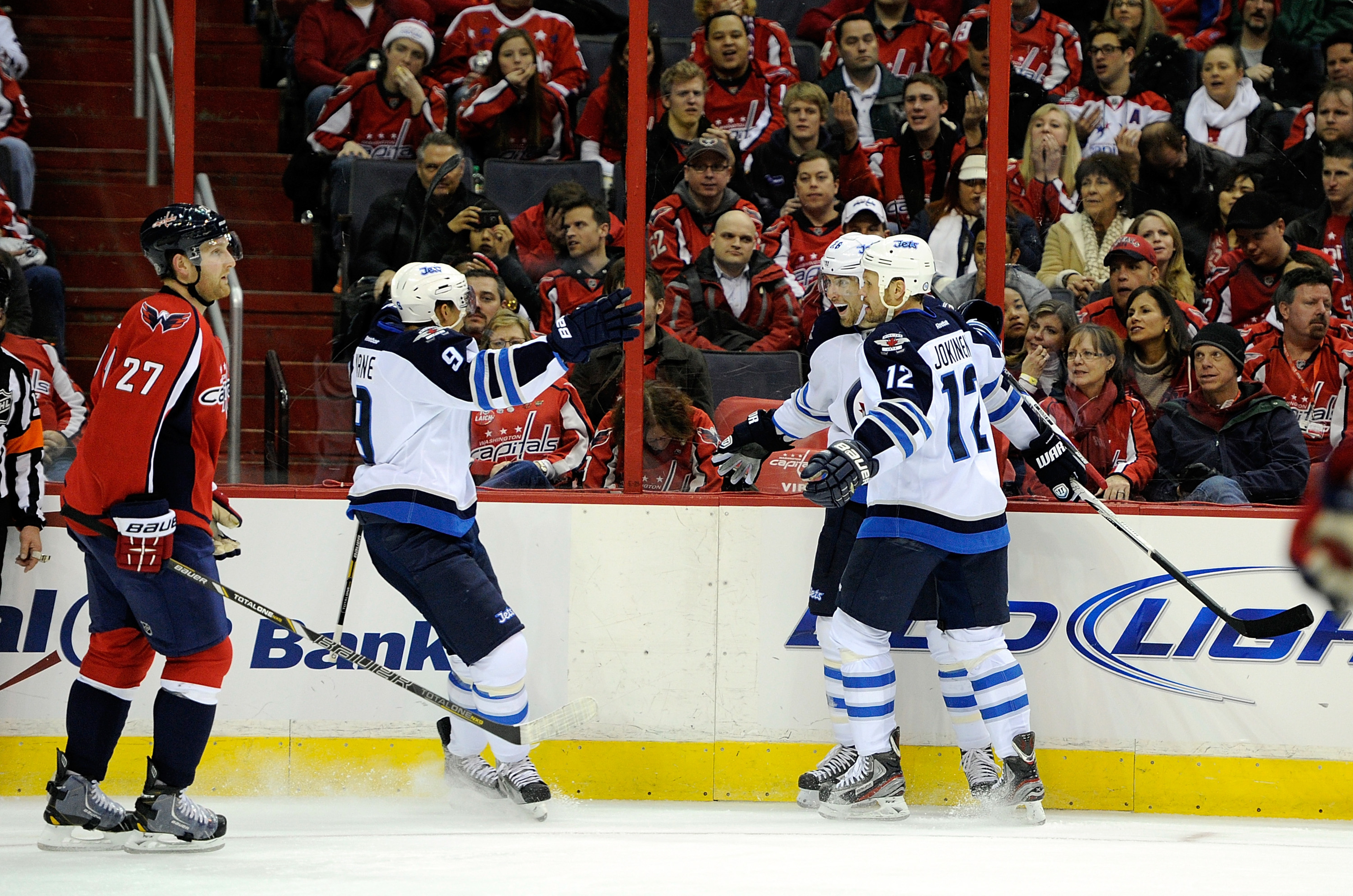 Evander Kane, #9, congratulates Blake Wheeler after his goal in Washington Tuesday night at the Capitals home opener. Jets won the game 4-2.
