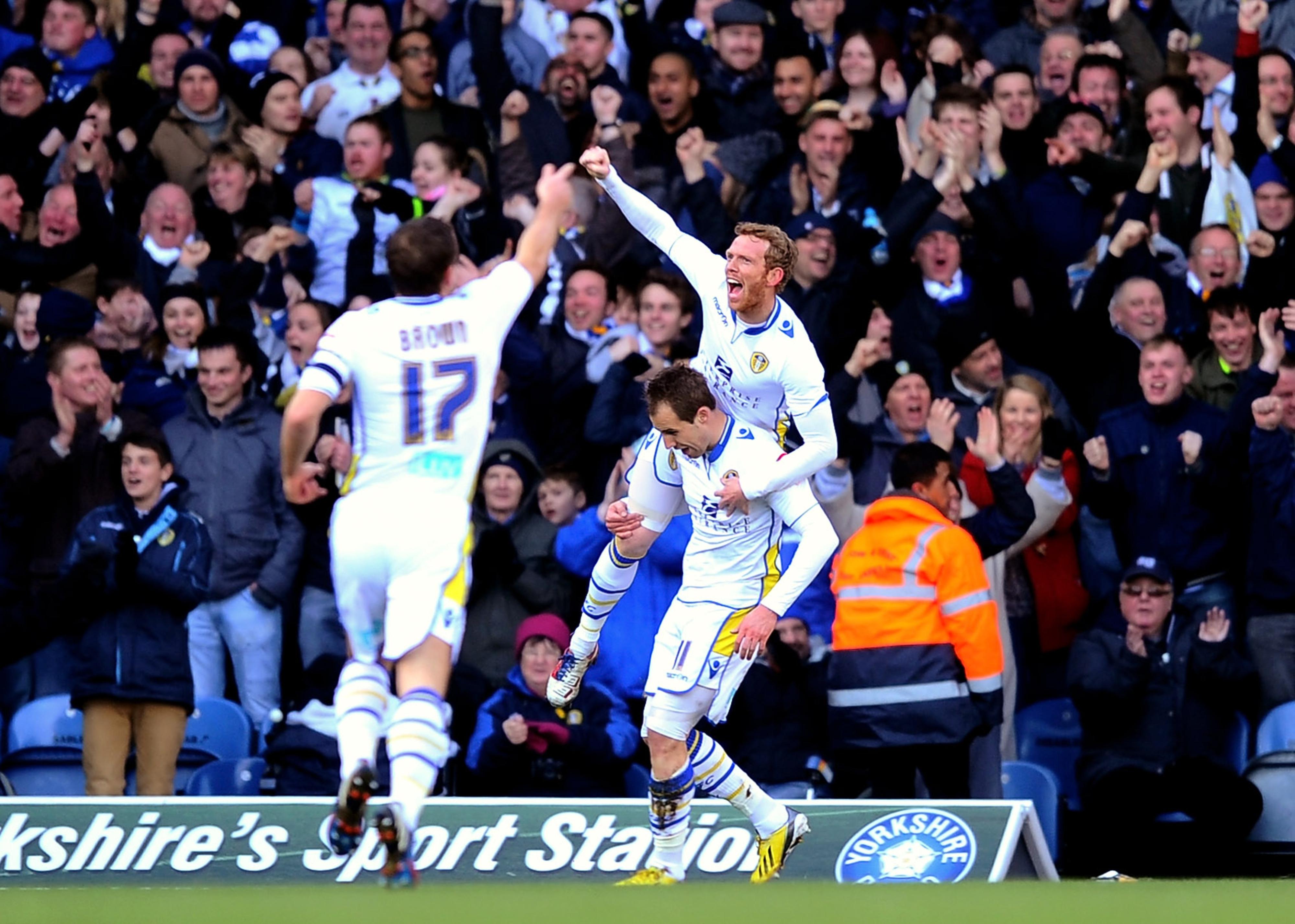 Captain for the day Michael Brown and Paul Green salute goalscorer Luke Varney.