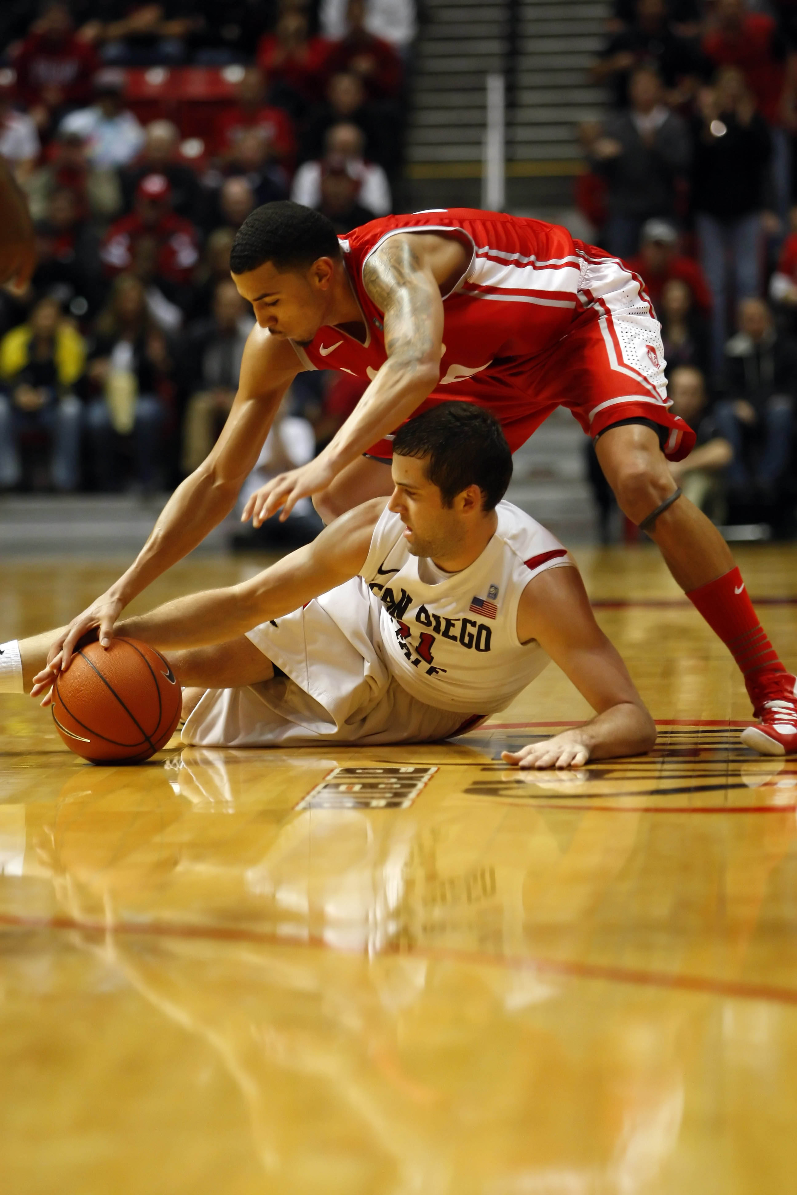SDSU's James Rahon (bottom) and UNM's Kendall Williams (top) battle for the ball.
