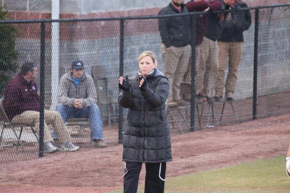 Vann, always animated in the third base coaching box, cheers on her team.
