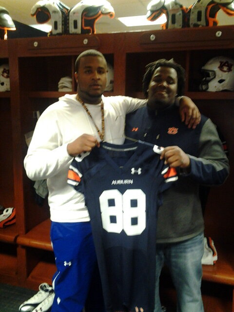 Johnson with former Hutchinson teammate and current Auburn player Ben Bradely on his Auburn visit
