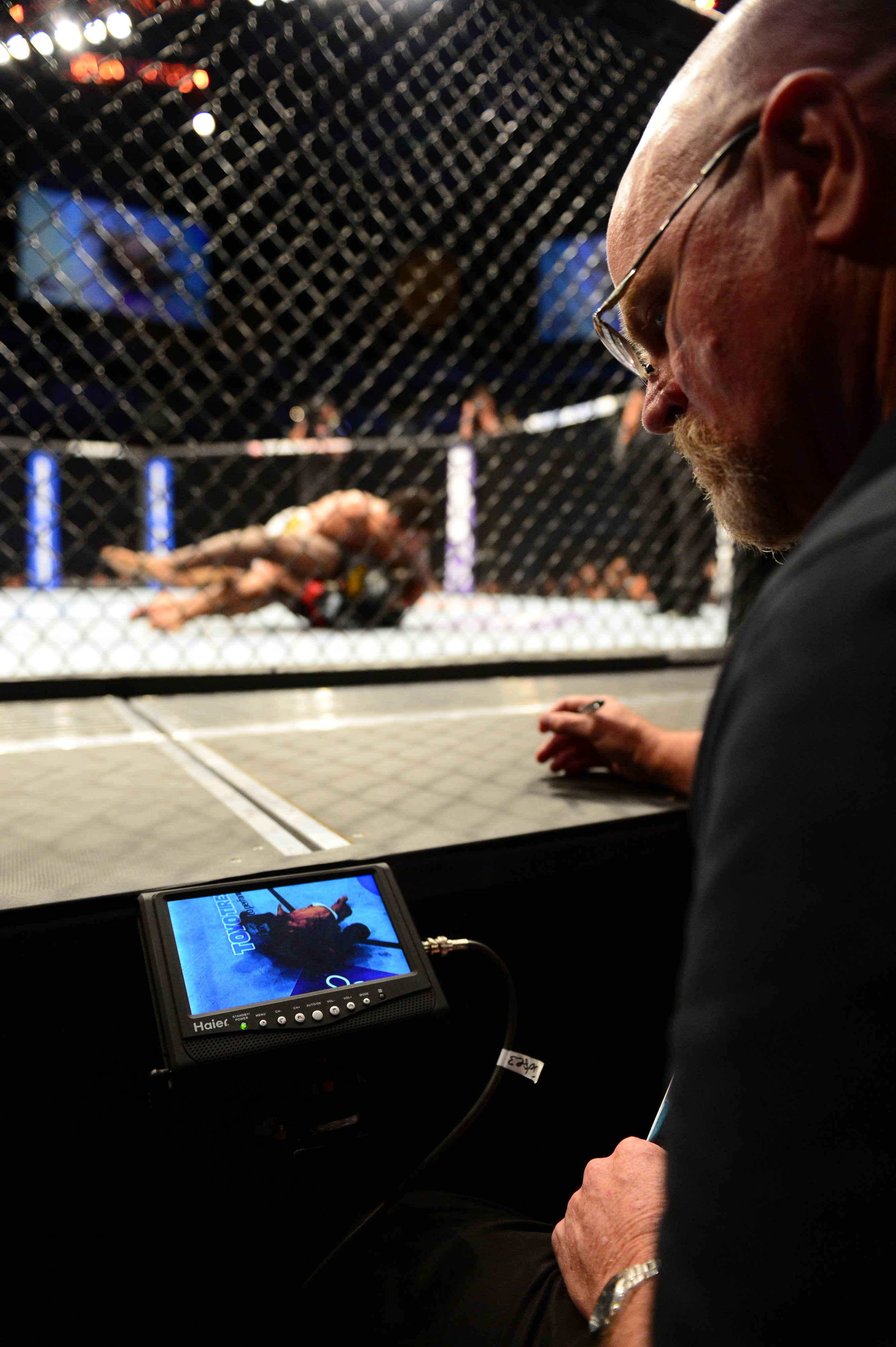 July 11, 2012; San Jose, CA, USA; A judge looks at his video monitor during a fight between Rafael Dos Anjos and Anthony Njokuani during the lightweight bout of the UFC on Fuel TV at HP Pavilion.