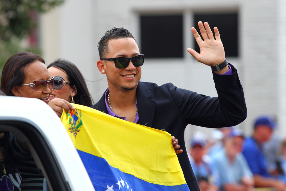 Carlos Gonzalez, holding a Venezuelan flag during festivities at the 2012 MLB All-Star Game, will represent his home country along with teammates Jhoulys Chacin and Ramon Hernandez at the 2013 World Baseball Classic.