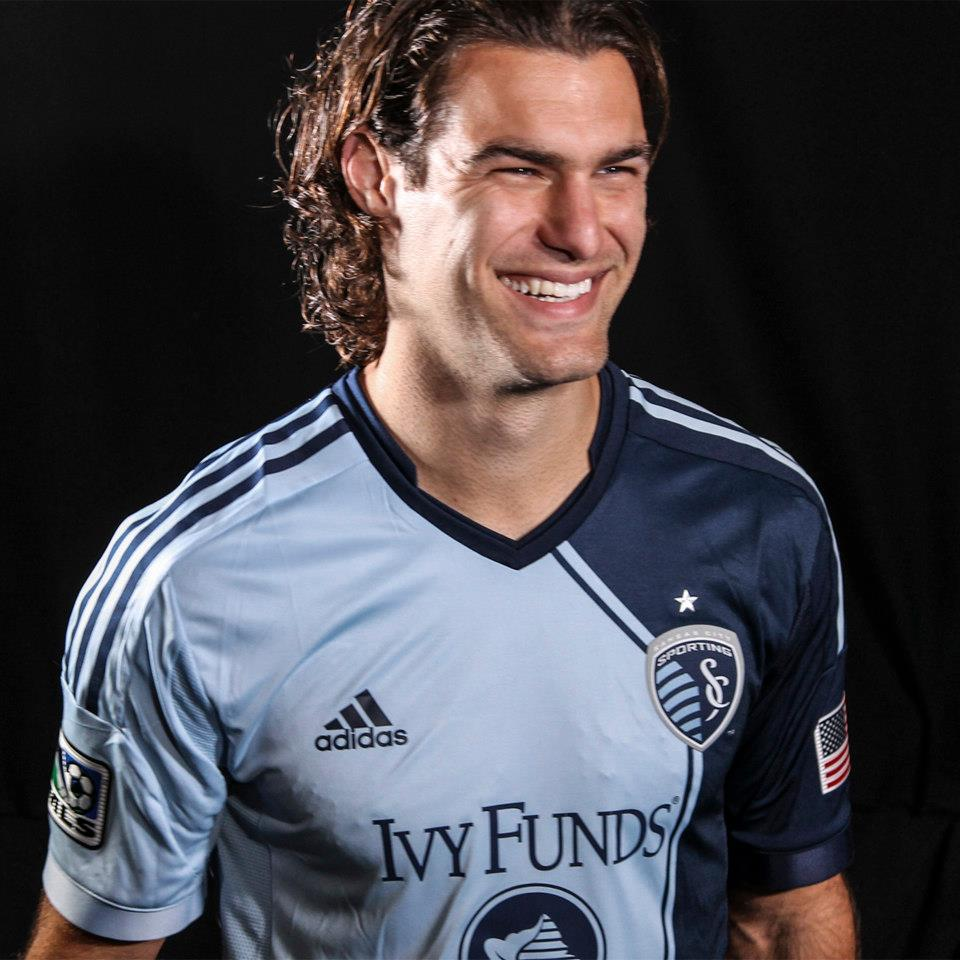 Graham Zusi shows off the new primary kit for Sporting Kansas City